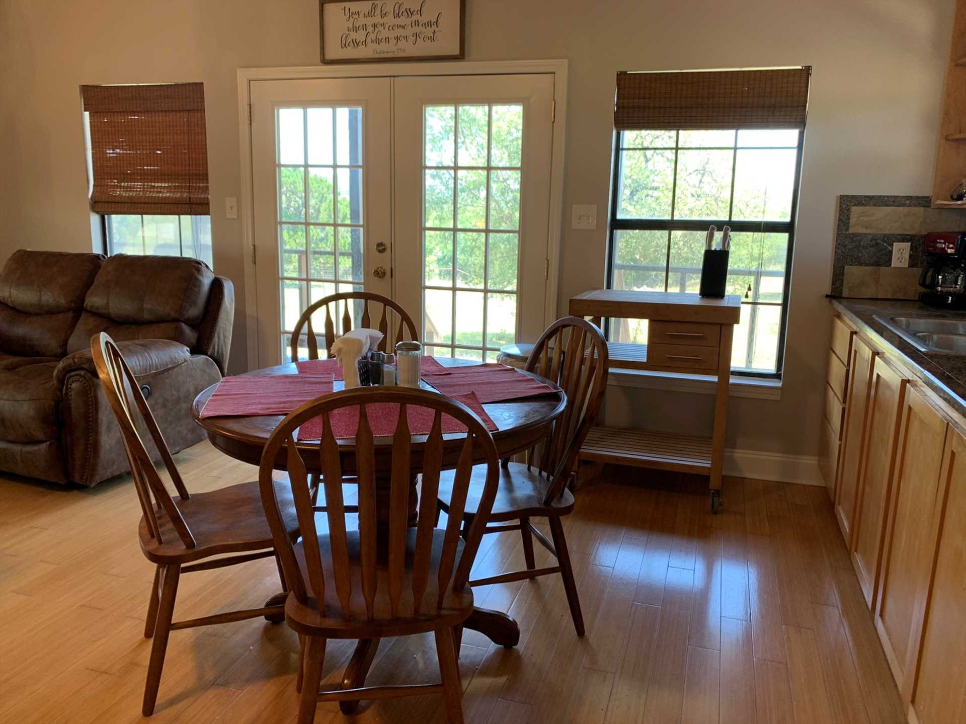 Seating up to four, the dining room table is positioned right by windows and French doors for a beautiful view of the great outdoors.