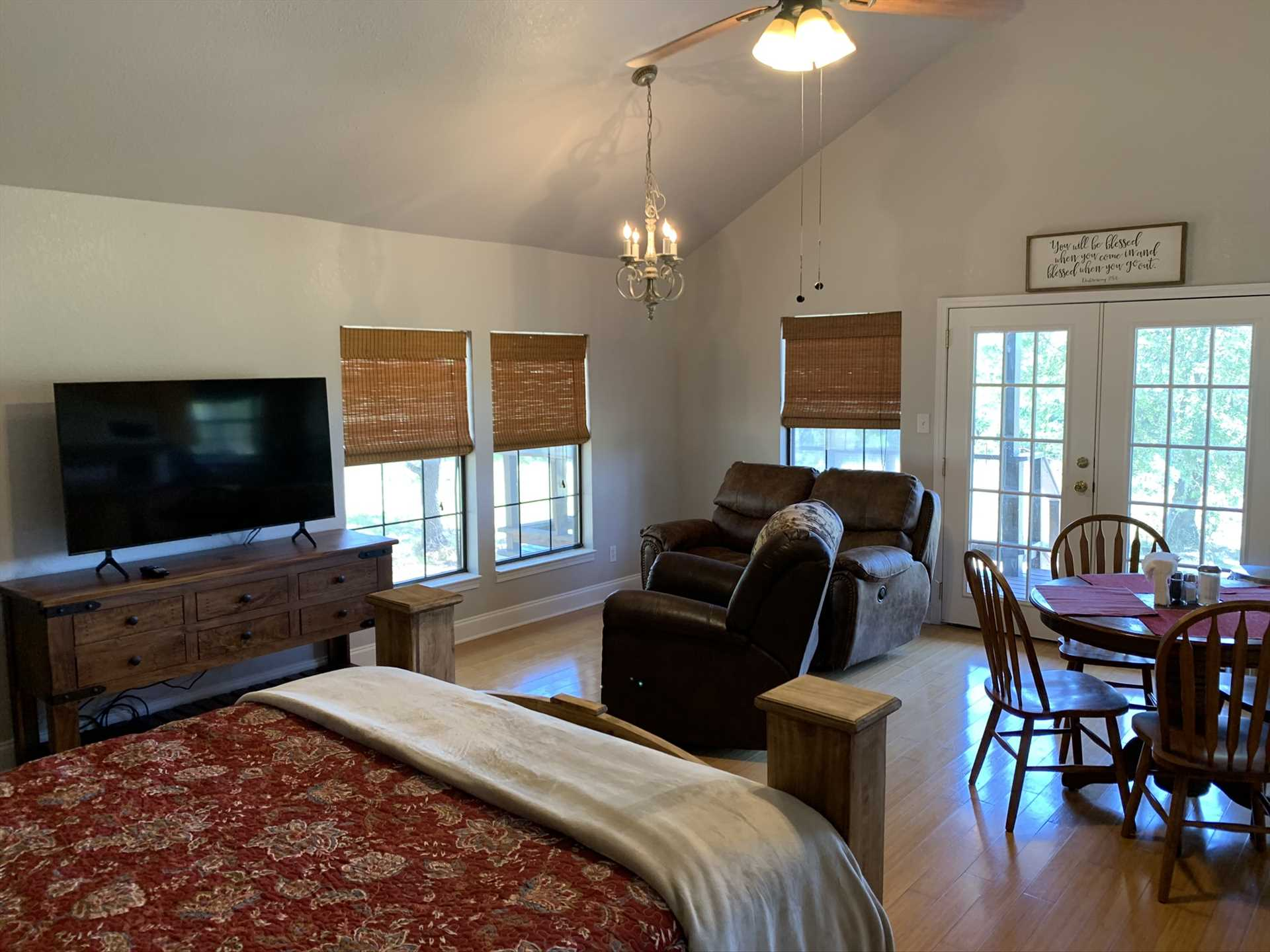 The open-floor plan of the cabin allows the French doors and windows to fill the space with warm natural light.