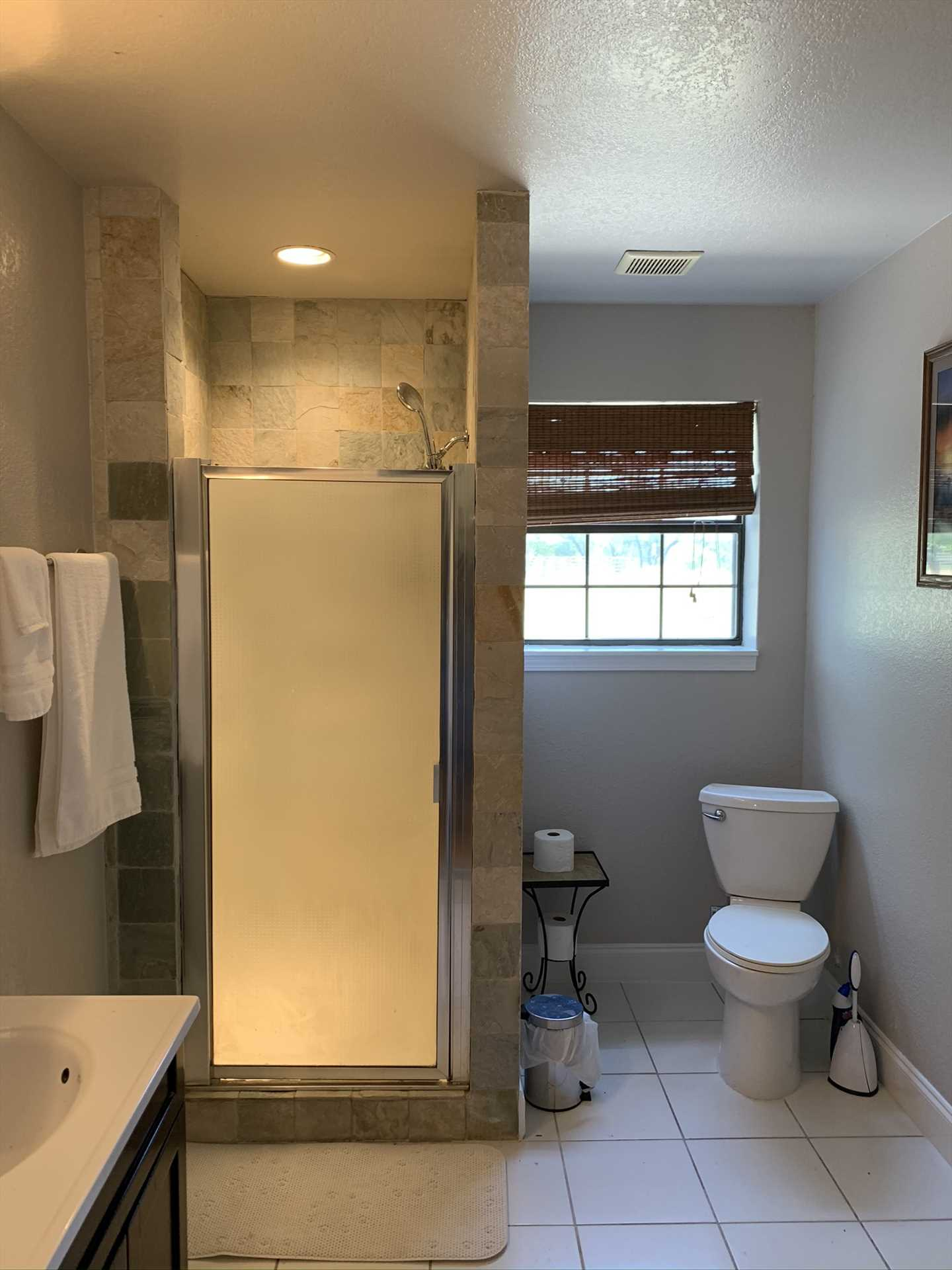 The spotlessly-clean full bath includes a shower, and is decked out with all the linens you'll need.