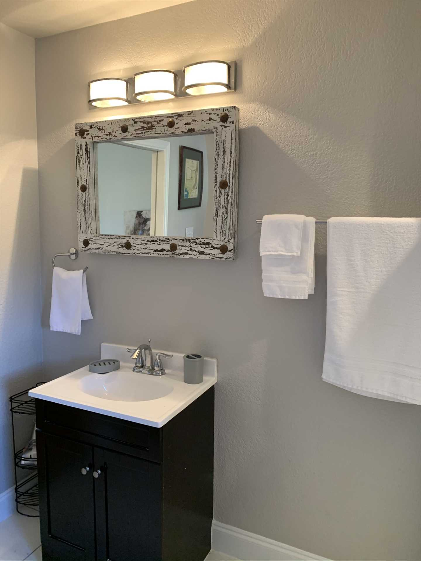 Subtle but friendly decorative touches, like the ornate mirror in the bathroom, help make the Hideout a comfortable guest home for your intimate holiday.