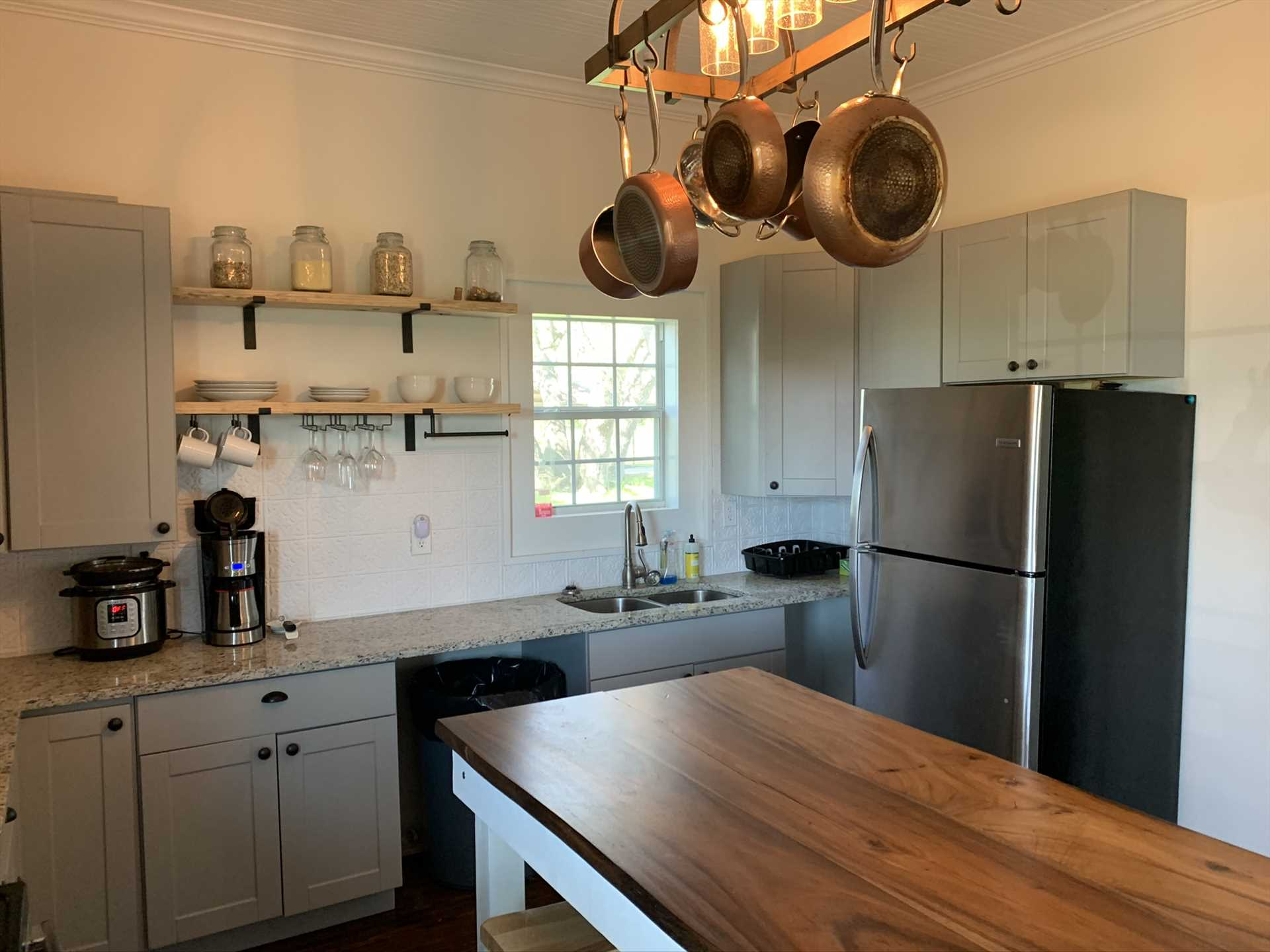The cooks in your crew will love the appliances, cookware, and serving ware provided in the comfy country kitchen.