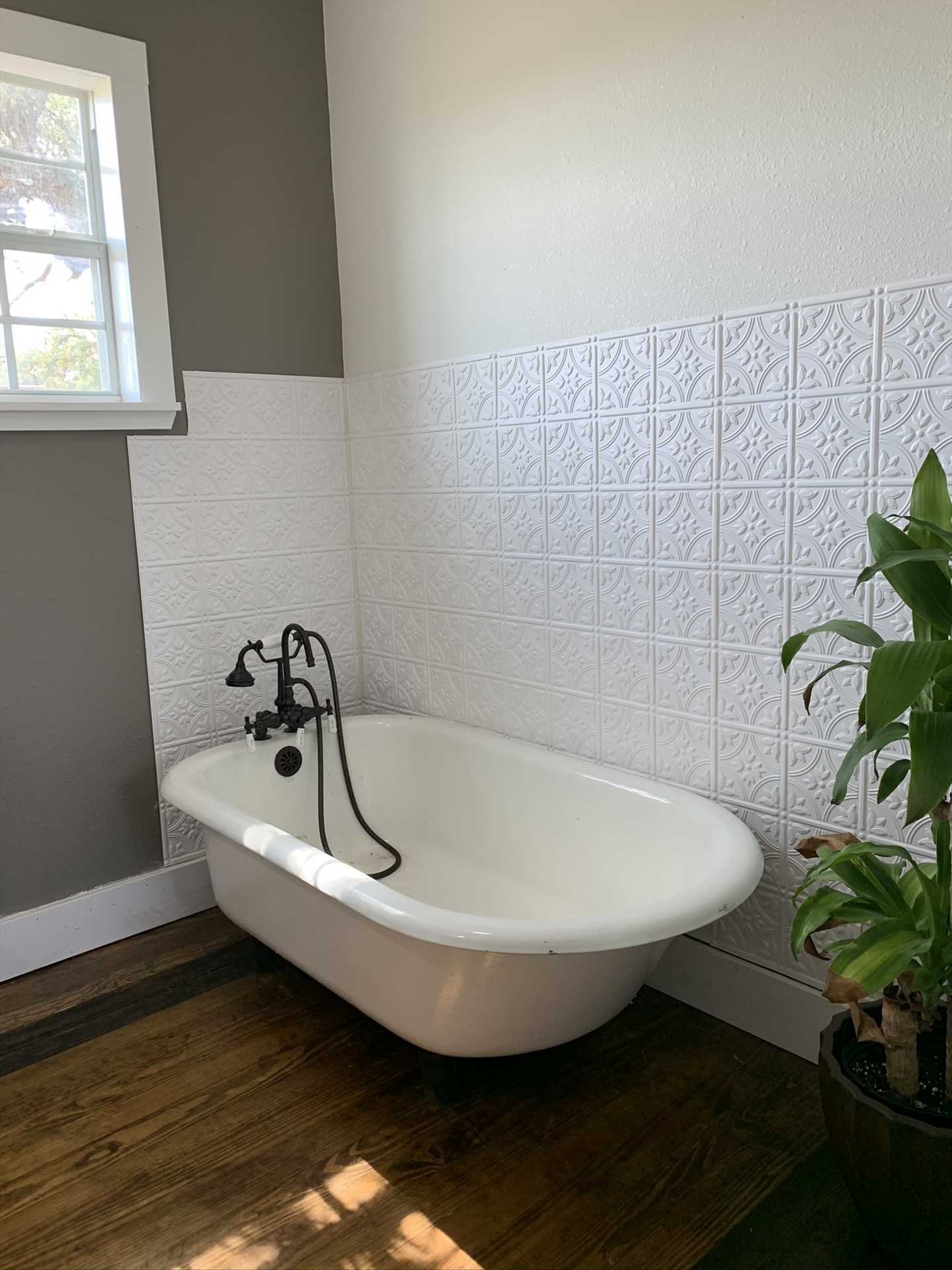 The second bathroom also features a second antique clawfoot tub, which also includes a handy shower attachment.