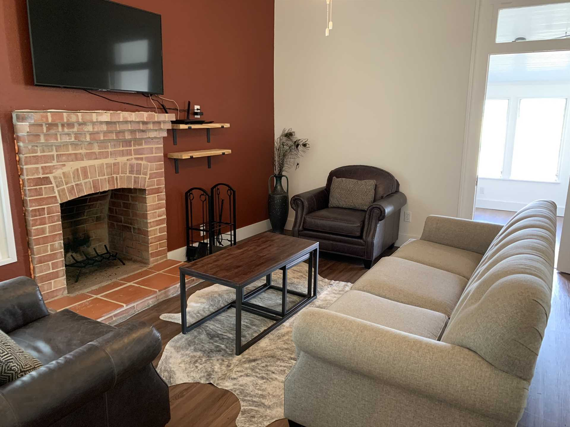Wifi and the Roku-enhanced TV will keep your crew entertained in the comfy living area, and the electric fireplace will keep chilly nights at bay.
