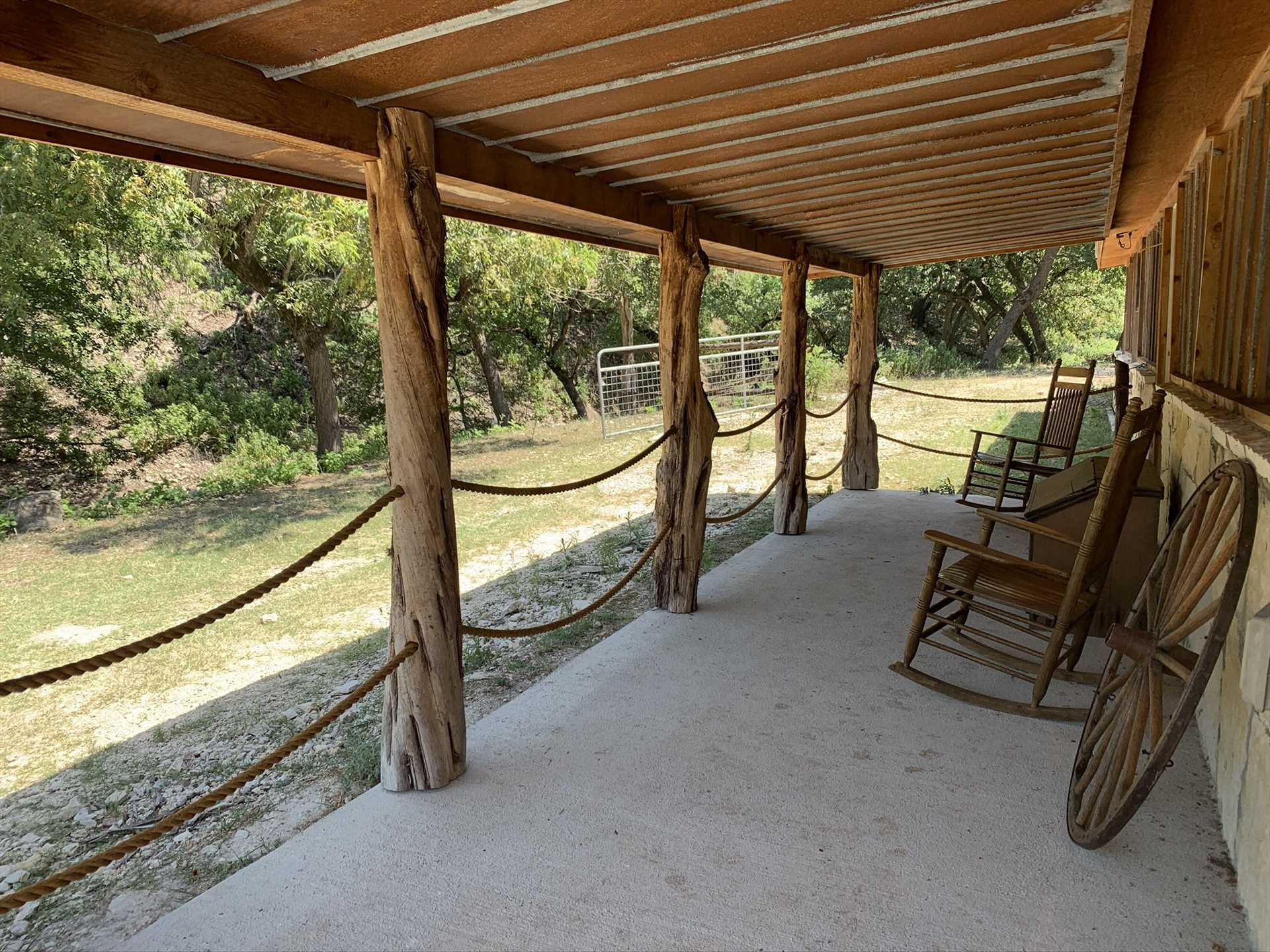 Rock away some quiet and relaxing moments with your creekside view from the shaded patio.