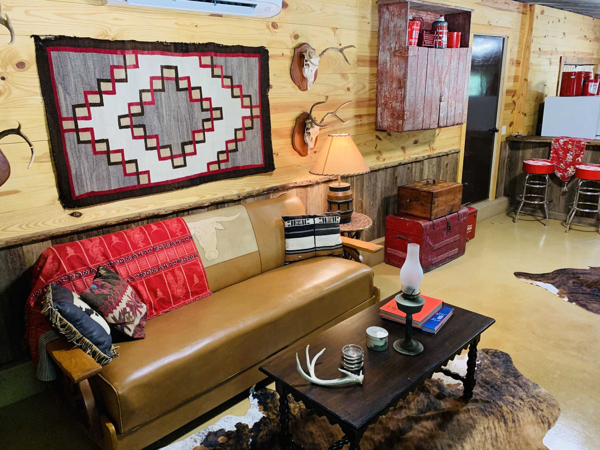 Sweet southwestern decor and plenty of leg-stretching room welcome you to the living area!