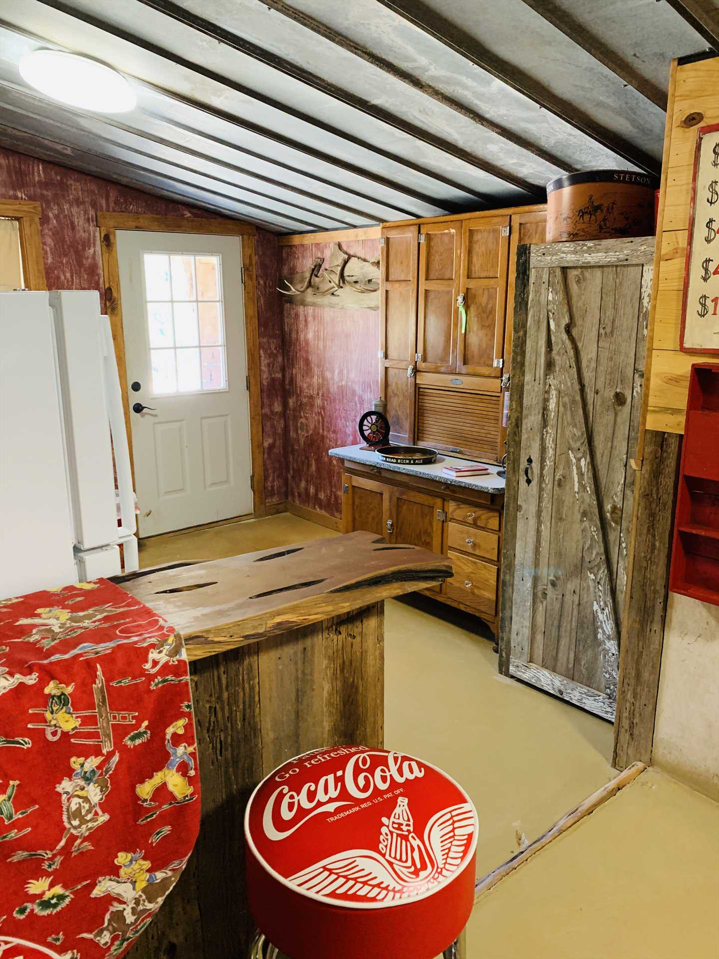Vintage rustic touches and corrugated ceilings give the cabin a unique and welcoming atmosphere.