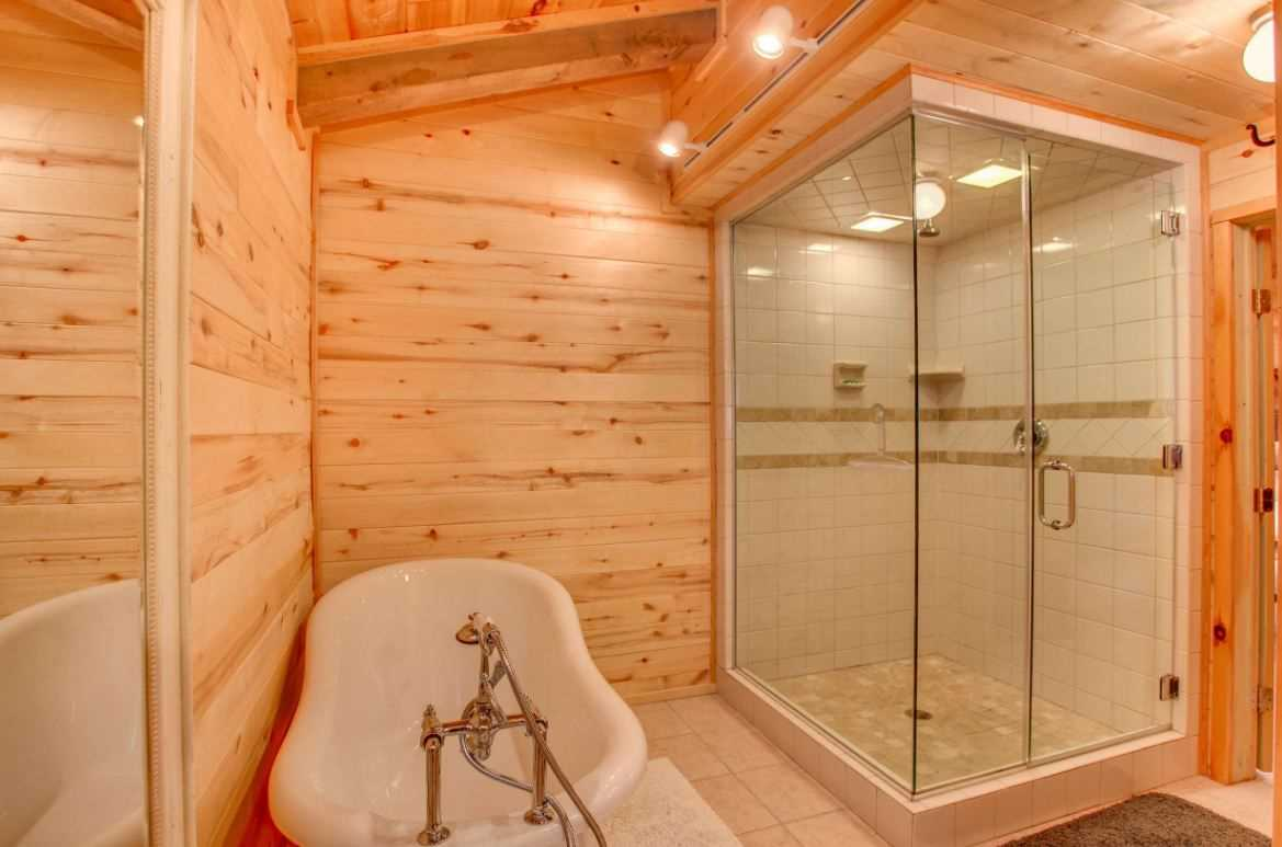 Our master bathroom is well lit and offers the guests their choice of a vintage claw foot tub or a nice and spacious stand up shower. We also provide bed and bath linens with your stay.