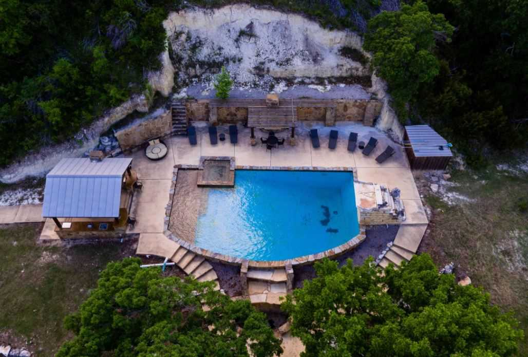 This amazing area is shared with the other property on site called the Lodge and can also be booked if you'd like. Here at the pool area you can find a hot tub, BBQ pit, and other touches to make your vacation as perfect as possible.