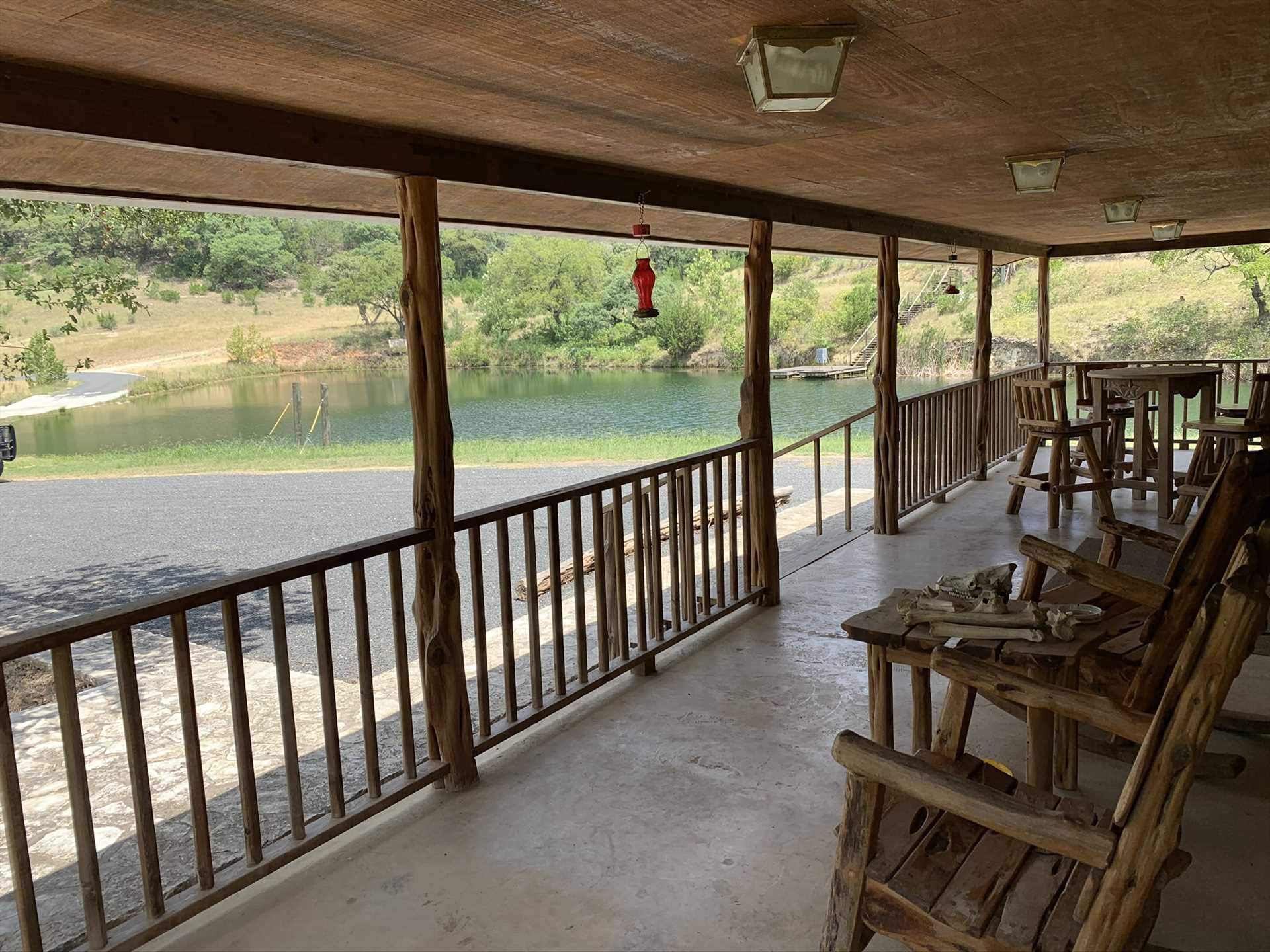 The shaded patio serves up stunning views of the waterfront, and bird feeders help bring the natural beauty to you!