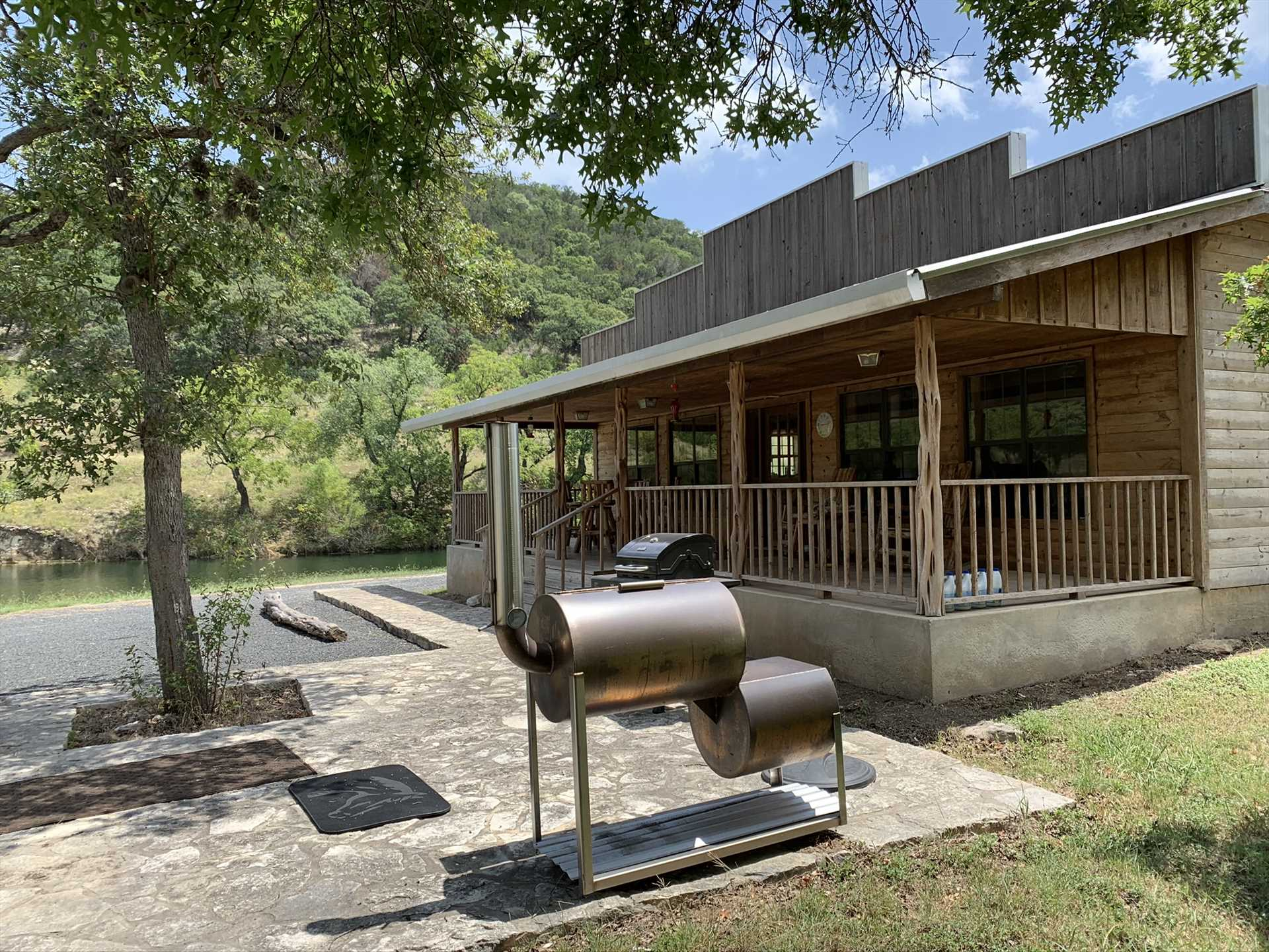 There's a charcoal grill here, AND...for those BBQ masters who want to really show off, there's a smoker, too!
