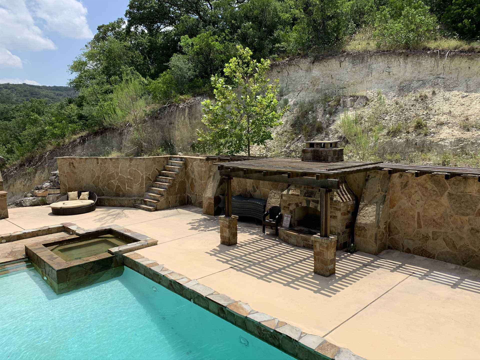 One more of the outdoor amenities here is the poolside fireplace! It adds a warm glow on cool nights.
