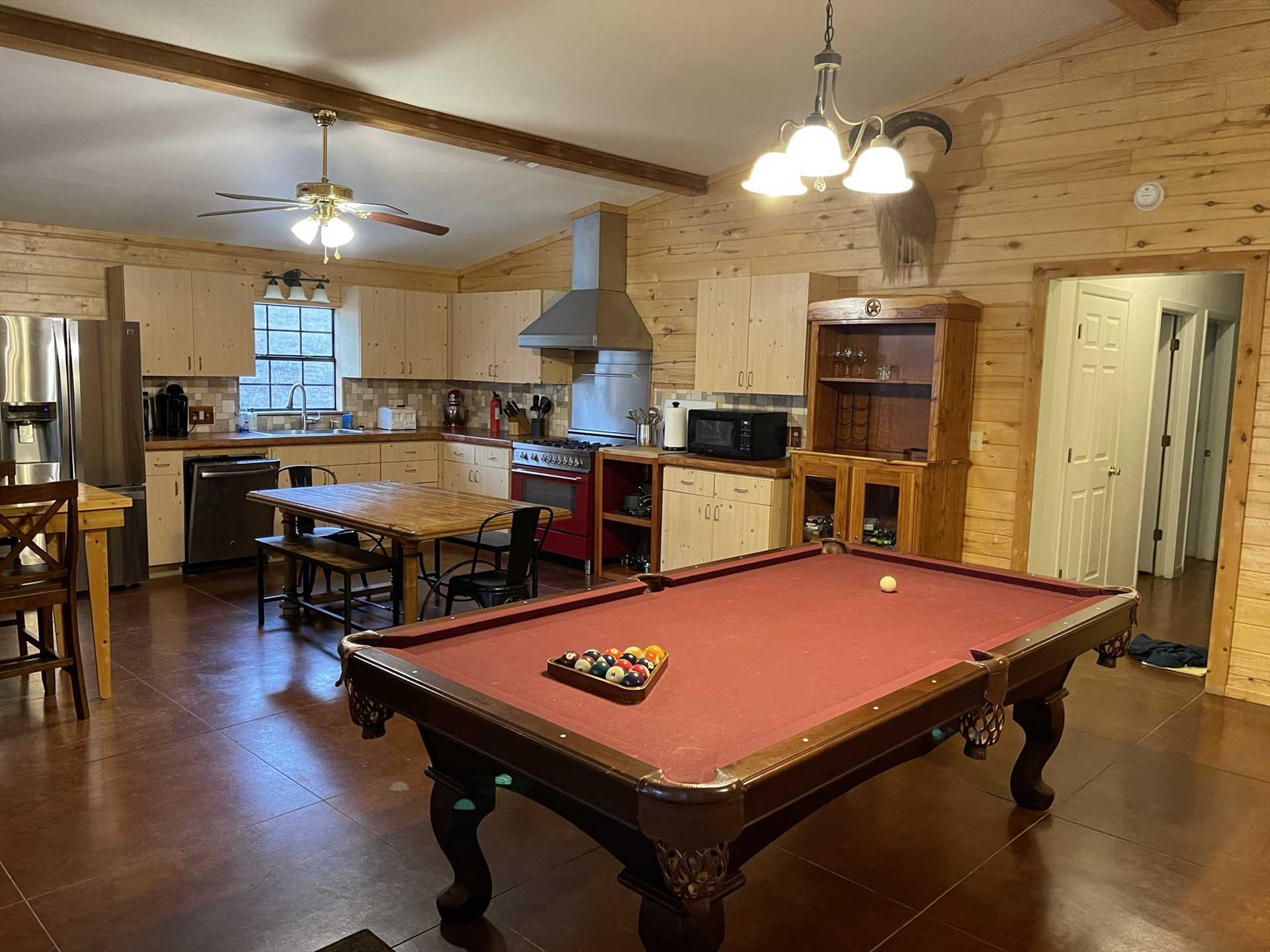 High ceilings and glowing woodwork create a welcoming atmosphere in the Lodge, and the entire space is climate-controlled with central AC and heating.