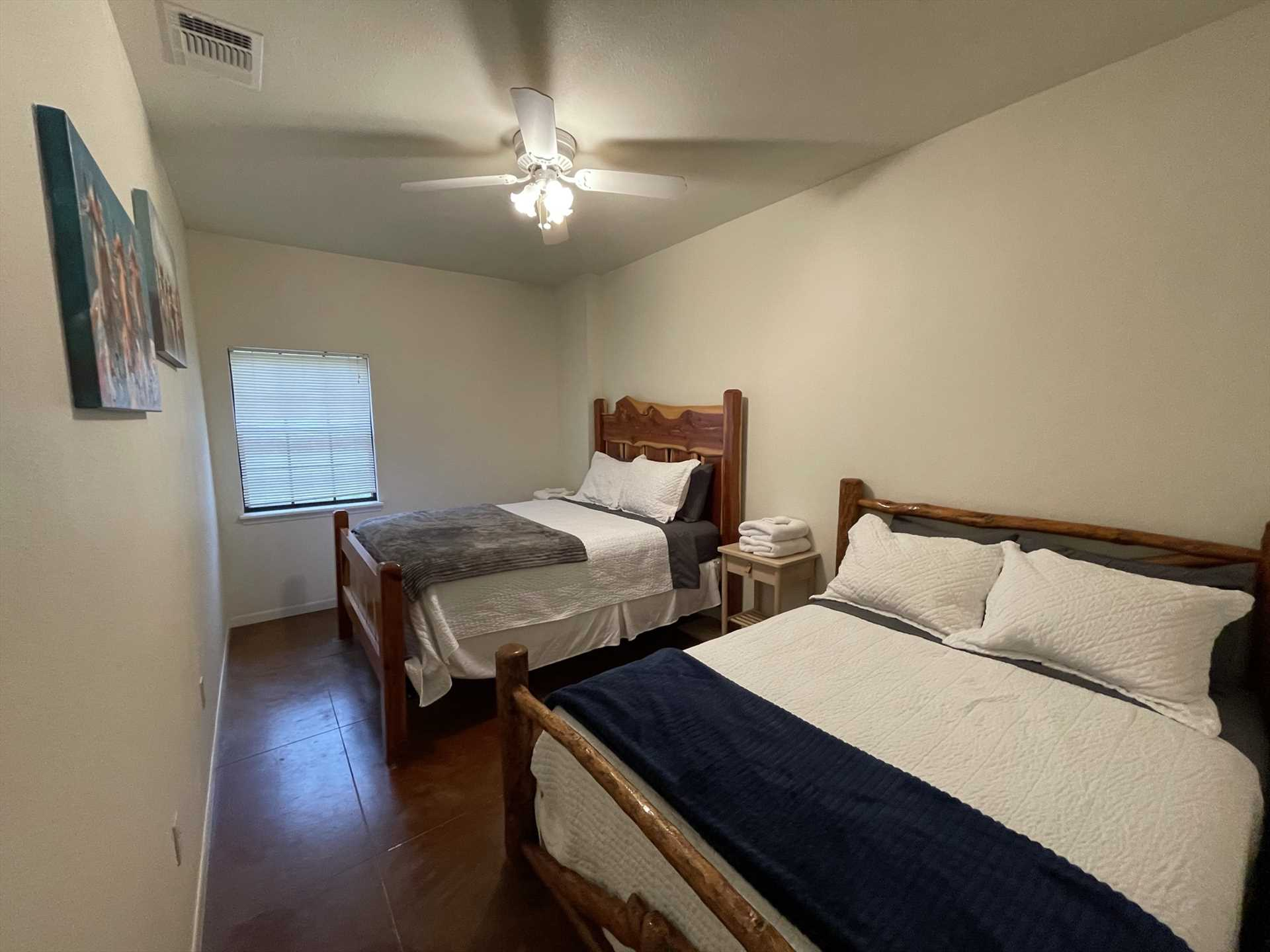 This is just one of four bedrooms in the massive Lodge, this one featuring two queen-sized beds. All bed and bath linens are provided for our guests!