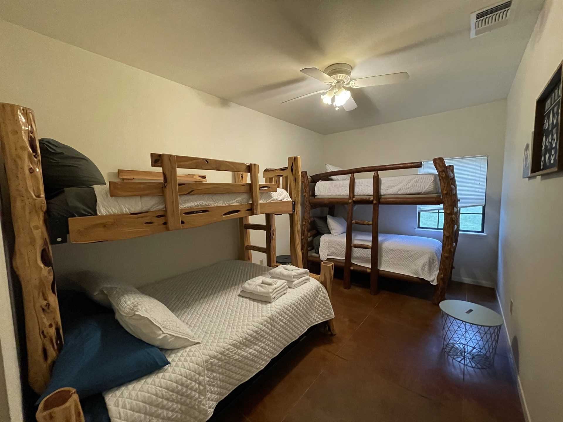 The two bunk bed sets in this bedroom provide a fun and comfortable place for the kids in your group when they need to call it a night.