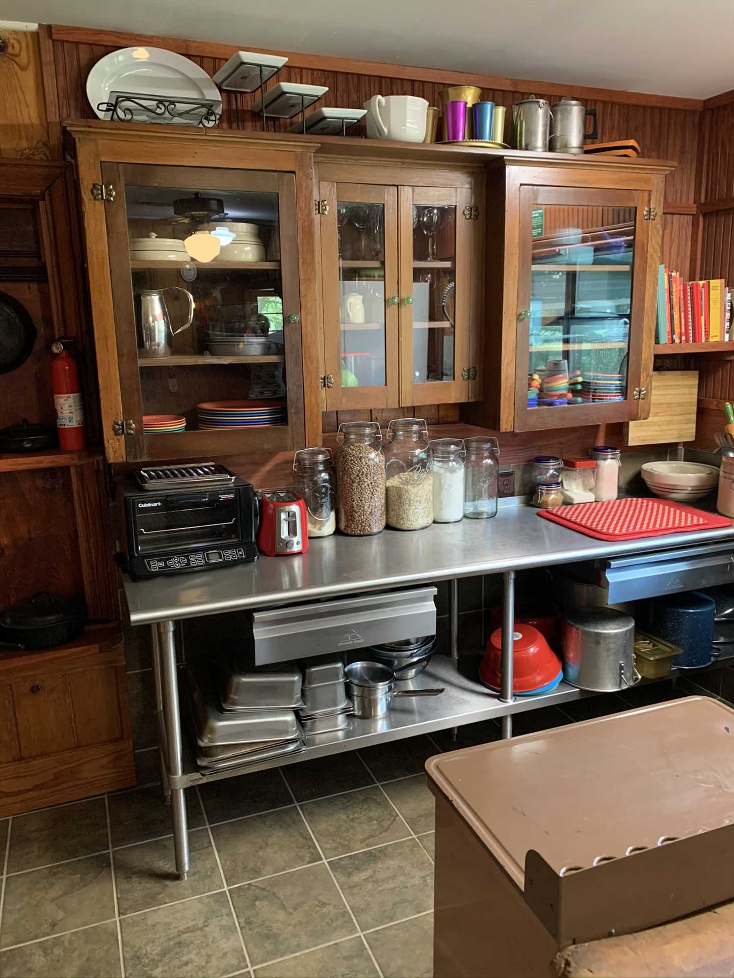 Tons of cookware, serving ware, utensils, and glasses are stocked in the kitchen for worry-free meal preparation.