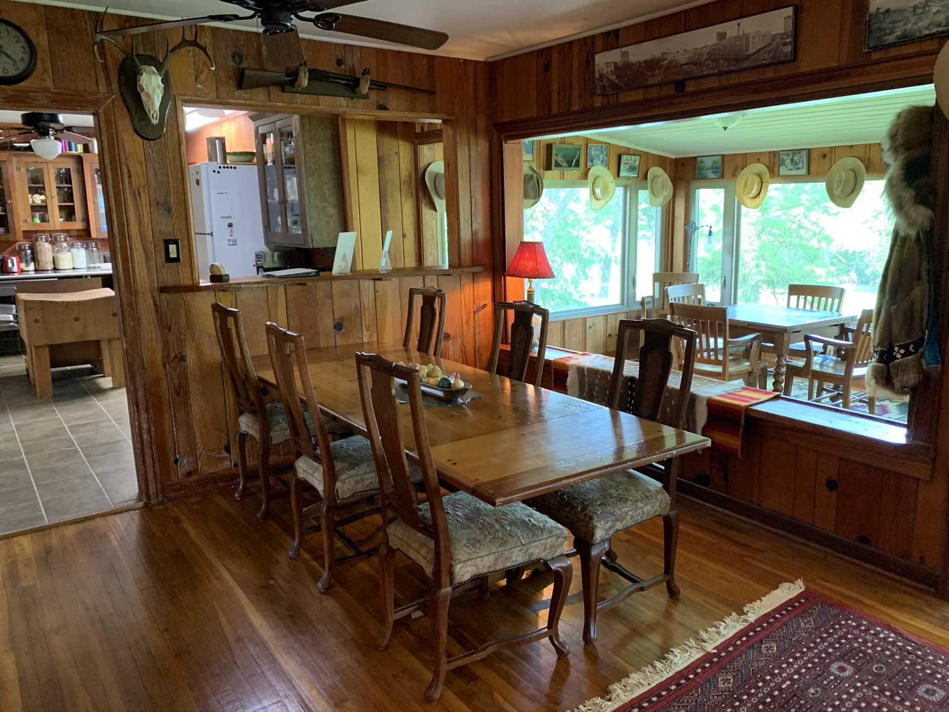Warm woodwork accents the dining area, a space that's also great for playing games and socializing.