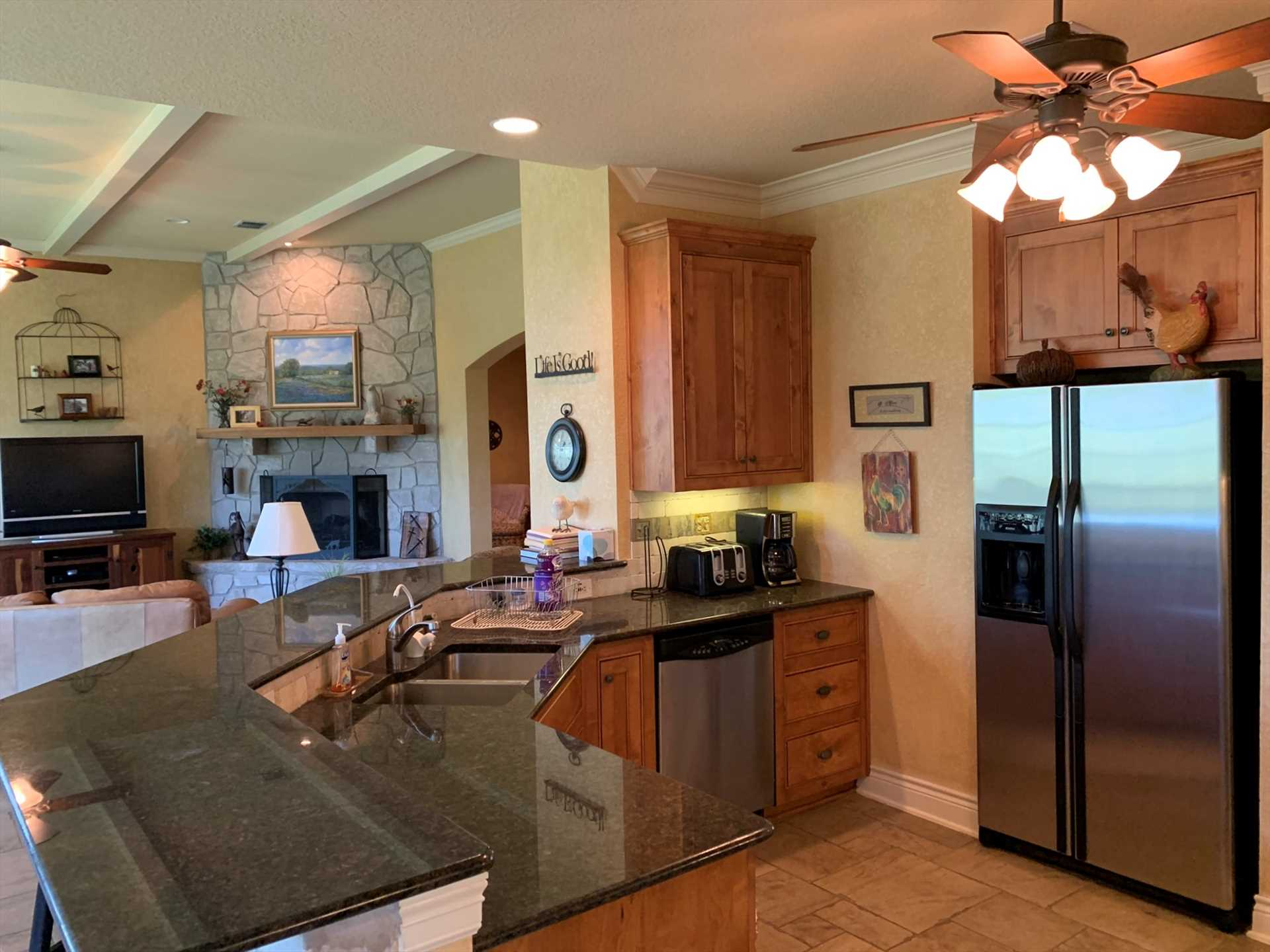The full and functional kitchen has modern appliances, and all the cooking ware, utensils, glasses, and serving ware to make your meals the best they can be. There's also a charcoal grill out back!
