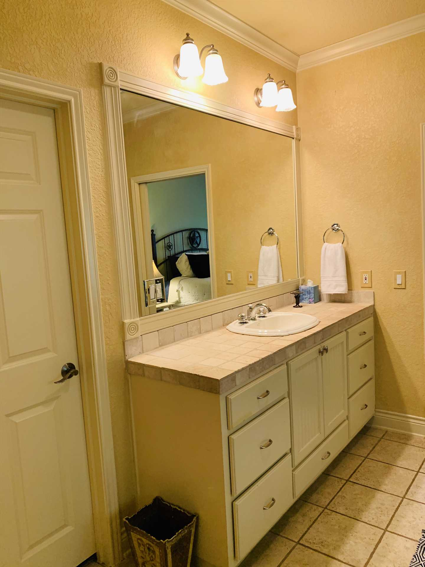 The master bath also includes a big vanity with plenty of counter space, a walk-in closet, and all bathrooms and bedrooms include plenty of soft and fluffy linens.