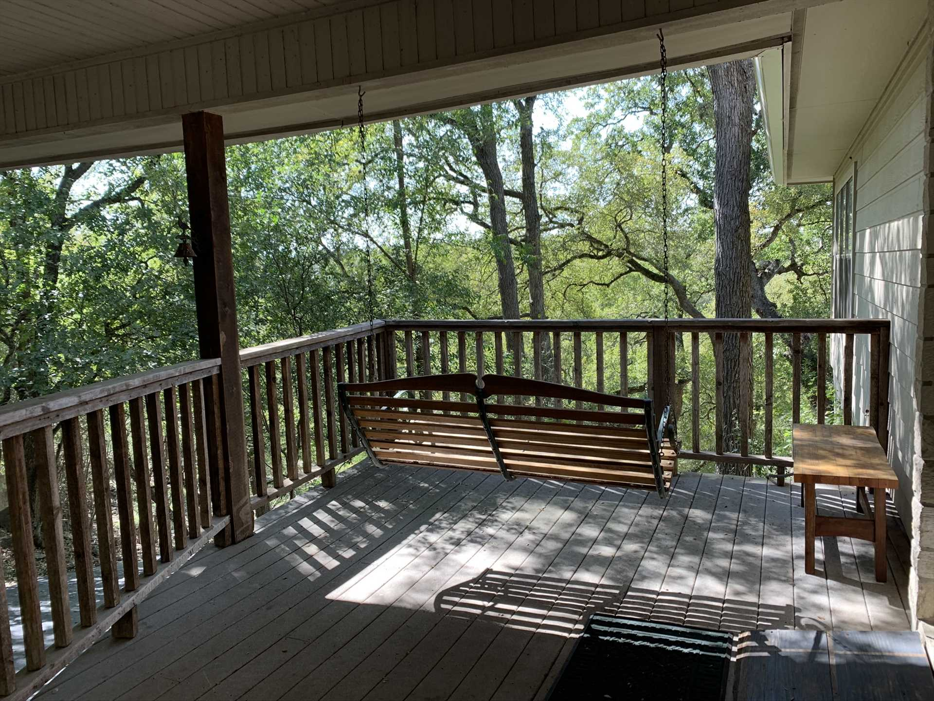 The side patio has a porch swing that provides a more intimate relaxation space.