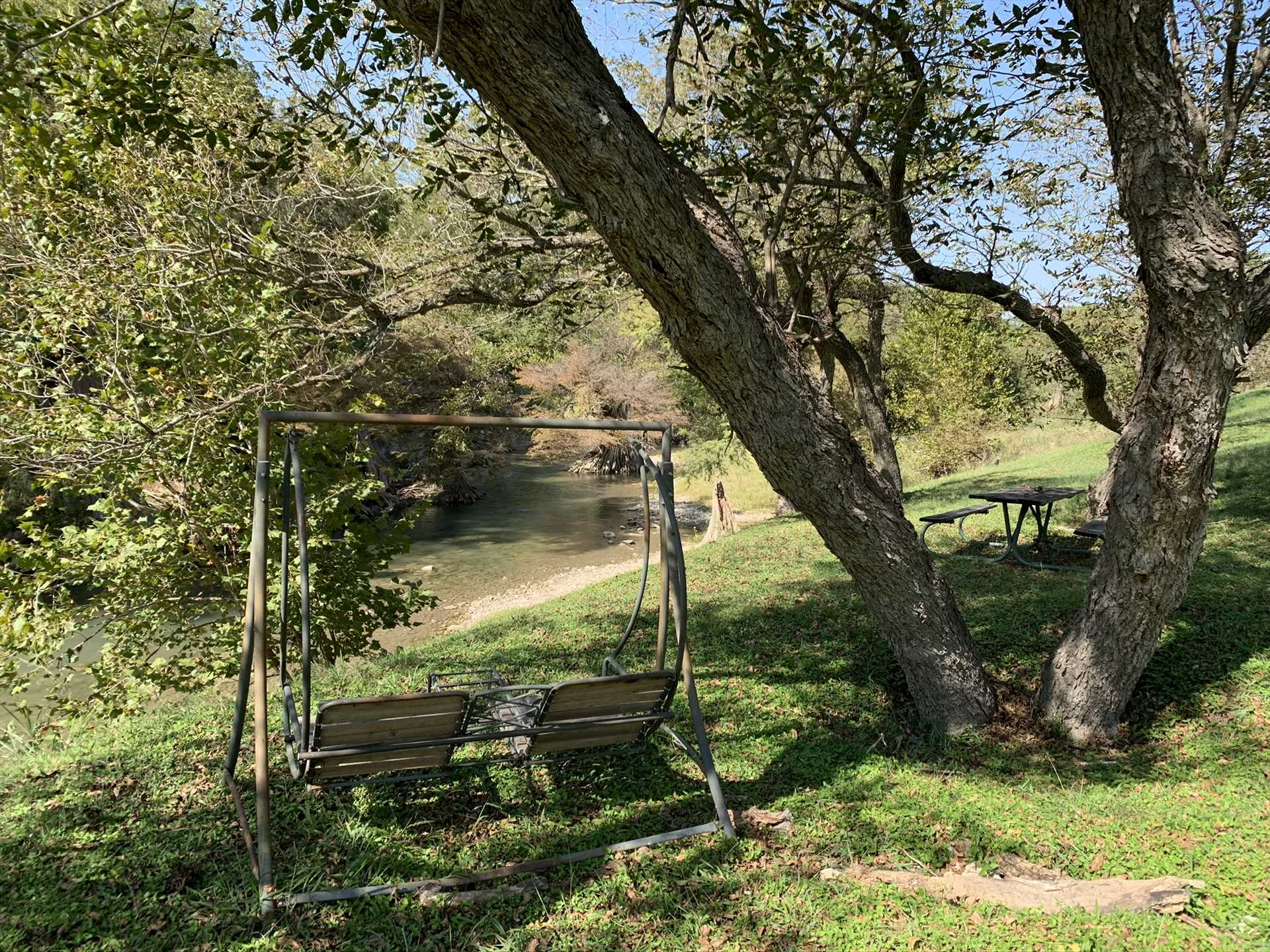 Swing in the shade with that special someone! It's a great place to sip a glass of Texas wine alongside the peaceful river.
