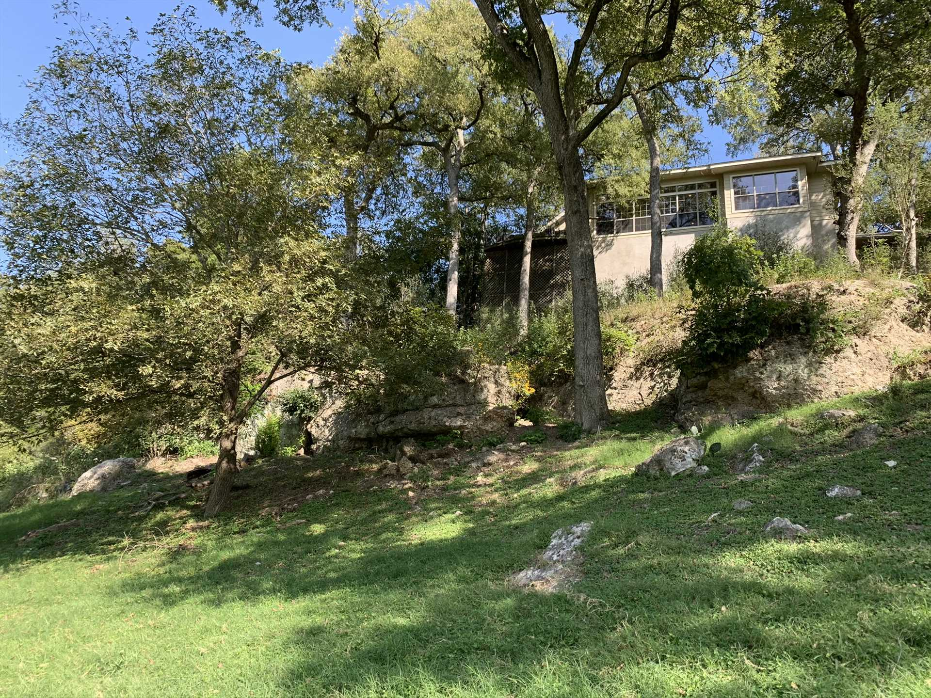 This is the Retreat as seen from the banks of the Guadalupe. Now, reverse that, and imagine the river view you'll have from the top of the cliff!