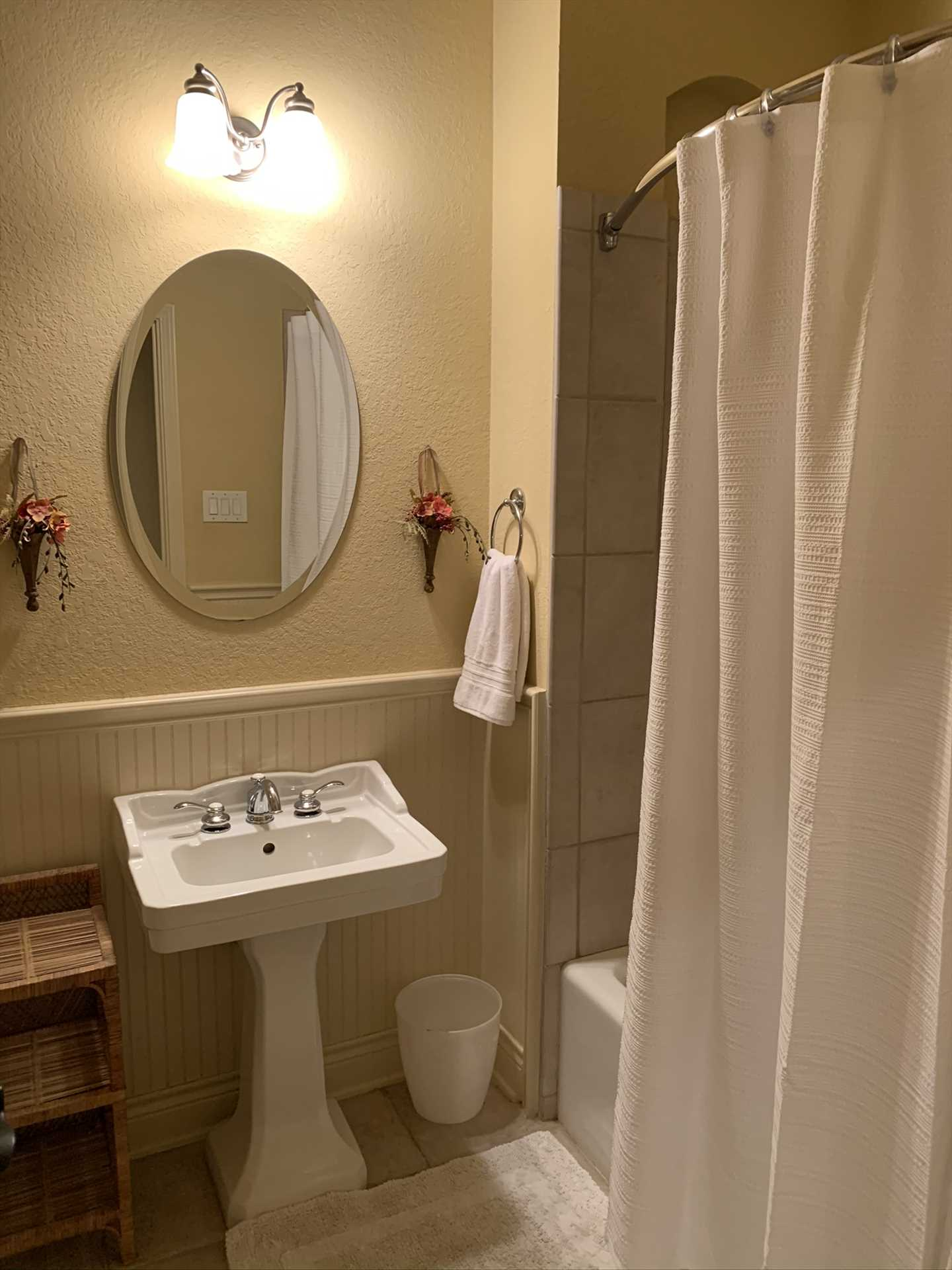 A second full bath, with a shower and tub combo, is located in the hallway convenient to the second and third bedrooms.