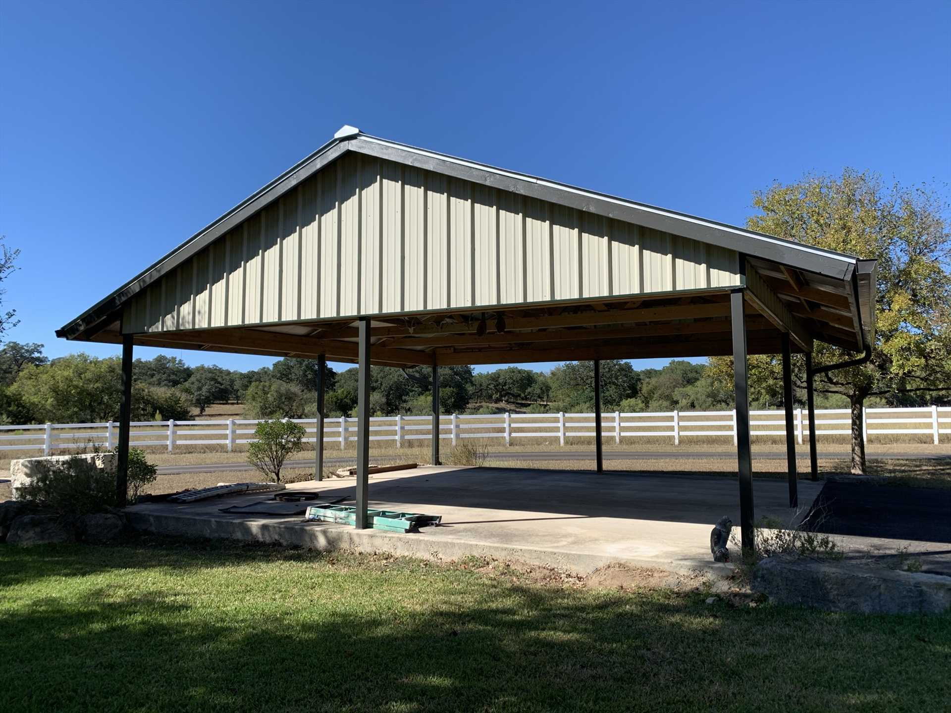 Even your vehicles will be pampered with the nearby shaded carport.