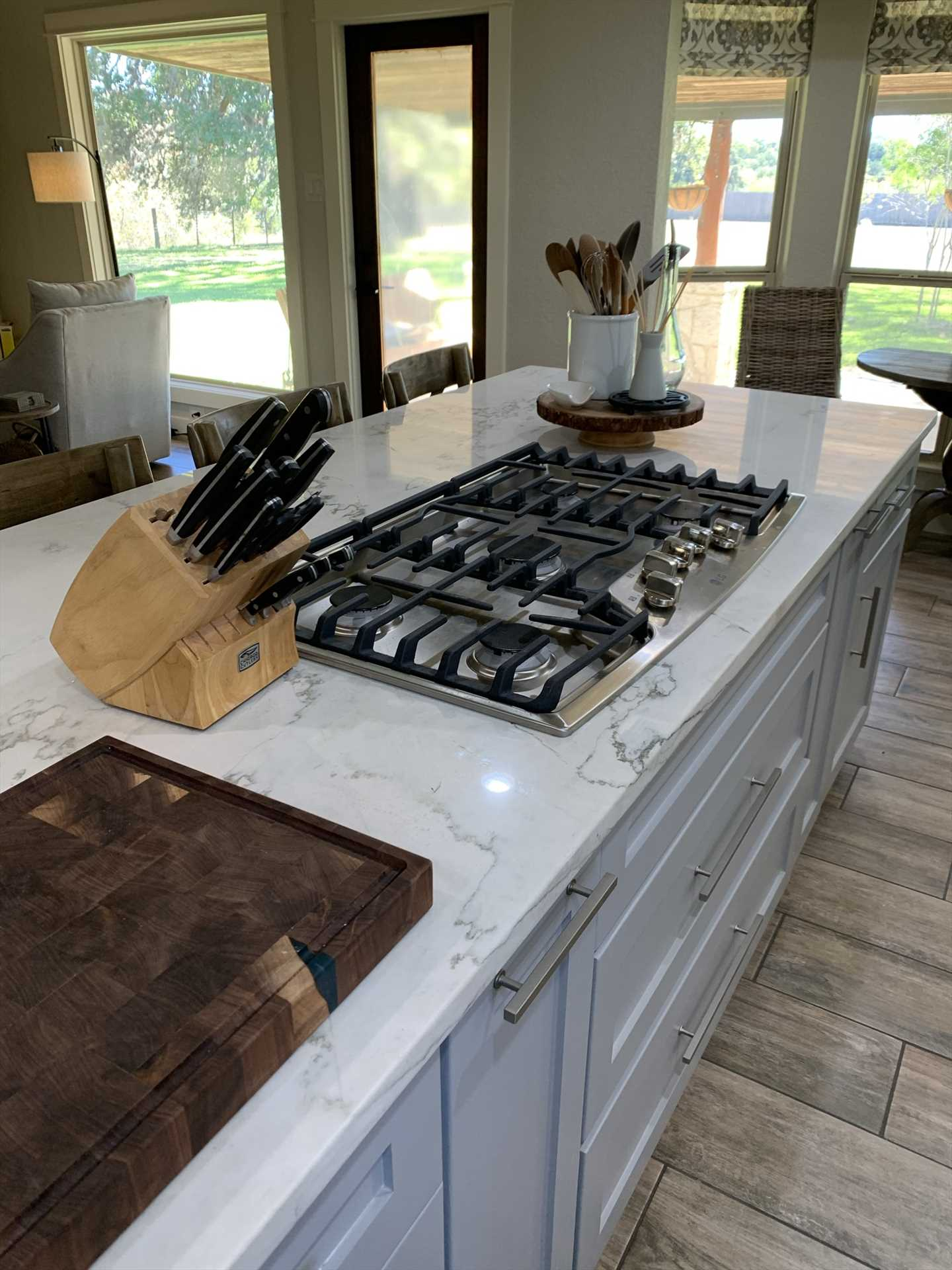 The big five-burner stove and wood cutting board are just two of the stations in the kitchen where your cooks can strut their stuff!