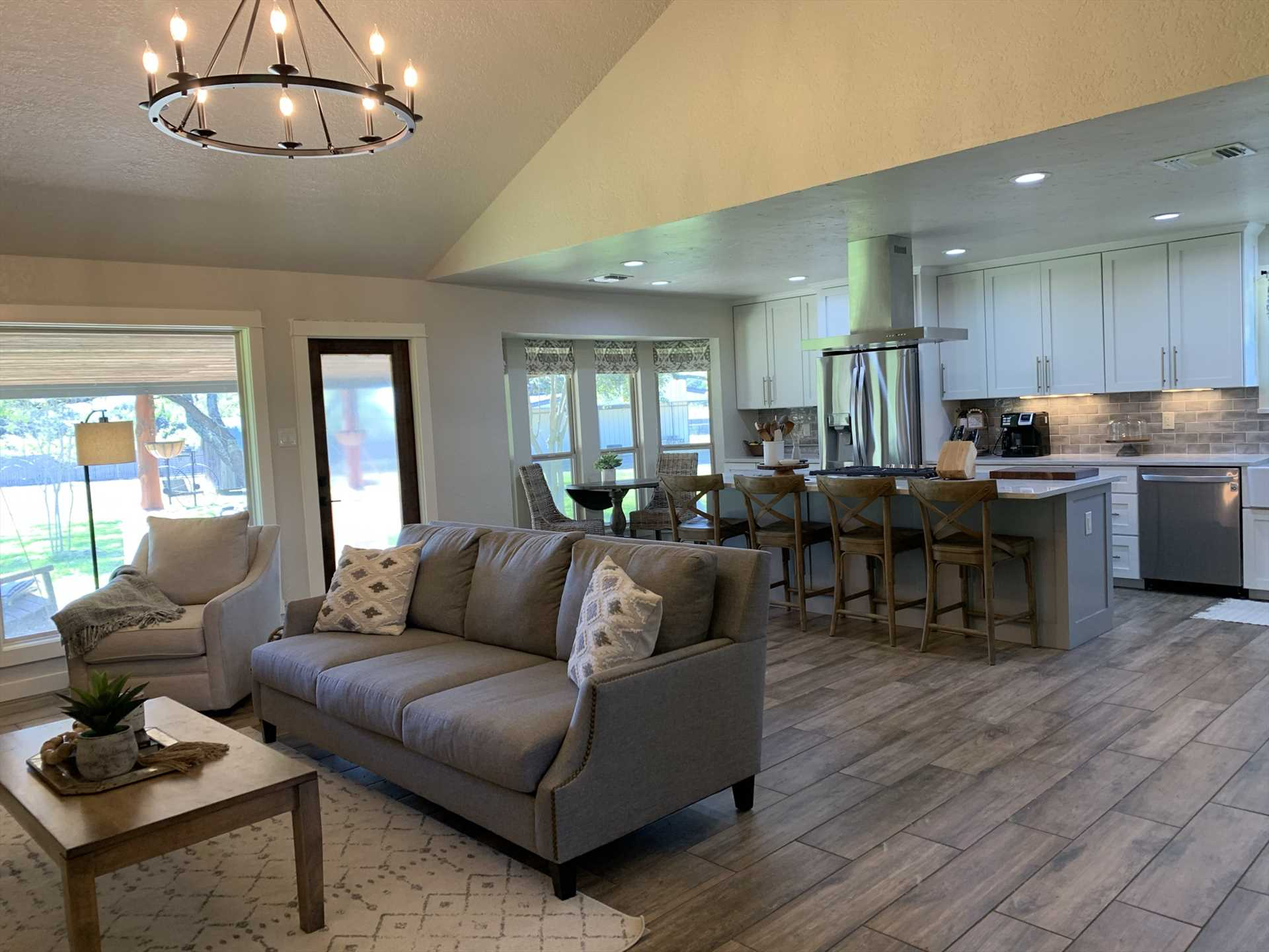 With a chandelier suspended from a vaulted ceiling and plenty of windows, the living area offers a regal space for entertainment and conversation. Cable TV and Wifi service help with that, too!