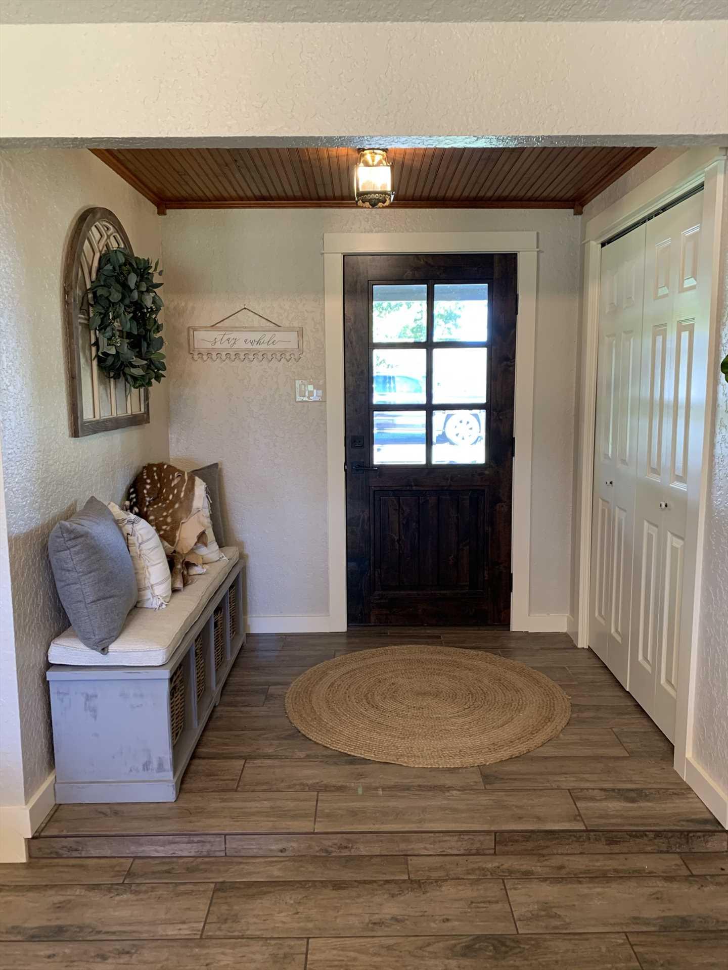 The tidy mudroom/foyer also offers some extra storage space!