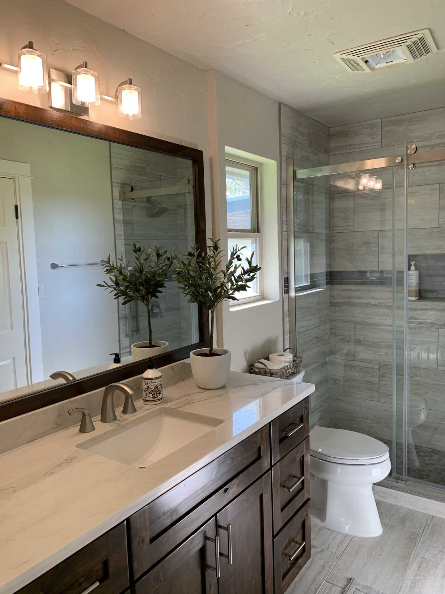 A roomy glass-walled shower and enormous mirrored vanity in the master bath also come with plenty of clean towels and linens. For added convenience, there's a washer and dryer here, too.