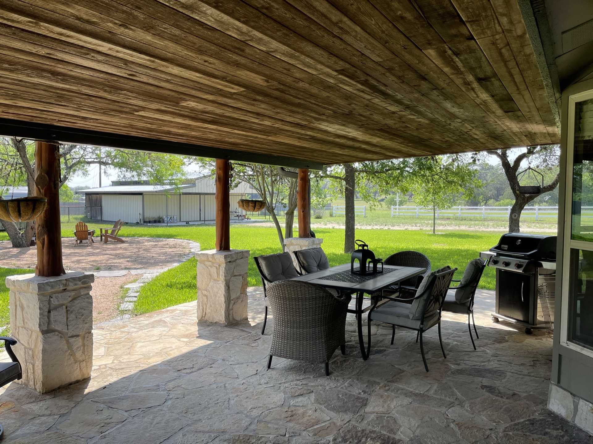 With a gas grill and generous outdoor dining space, all the ingredients are on hand for a fresh-air BBQ feast.