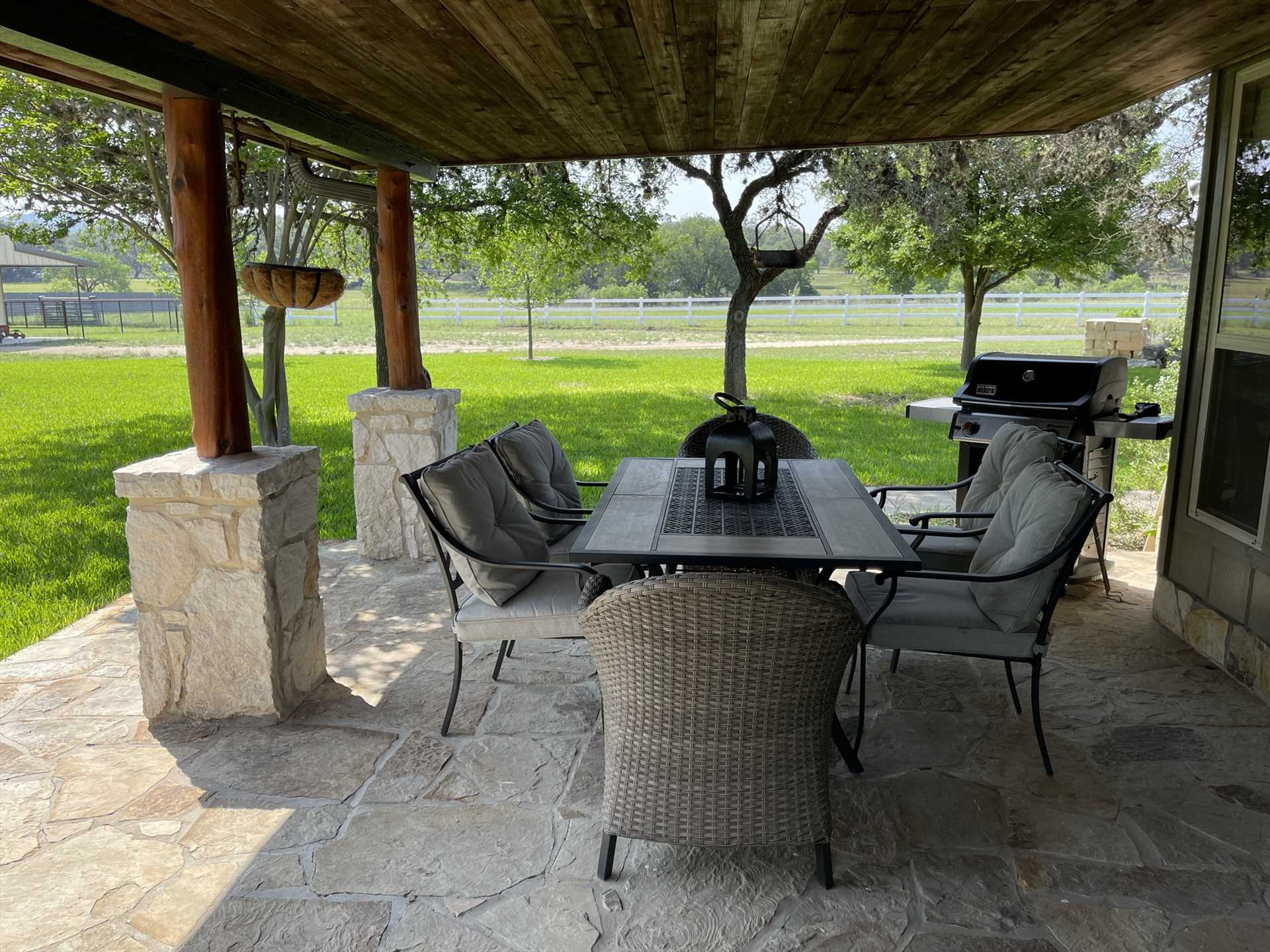 The comfortable and stylish setup on the shaded patio is like having a second living room!