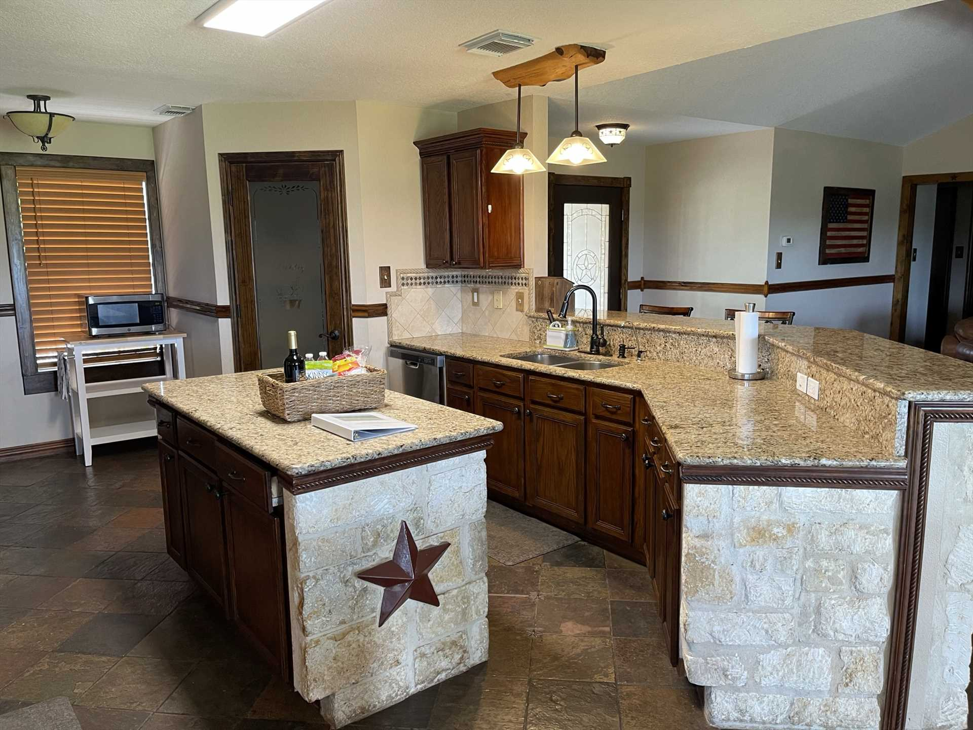 Modern appliances and plenty of counter space make the kitchen a foodie's dream!