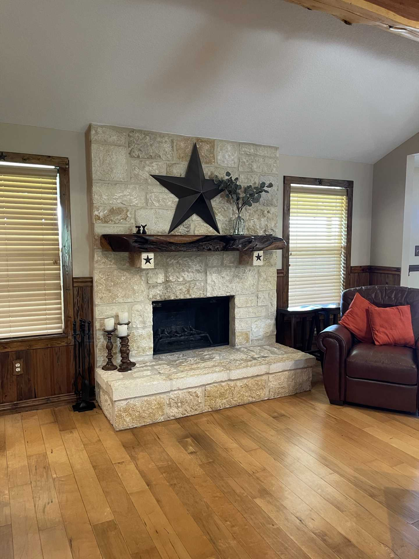 Lone star touches and stone work throughout the retreat give it a robust and welcoming ranch feel.