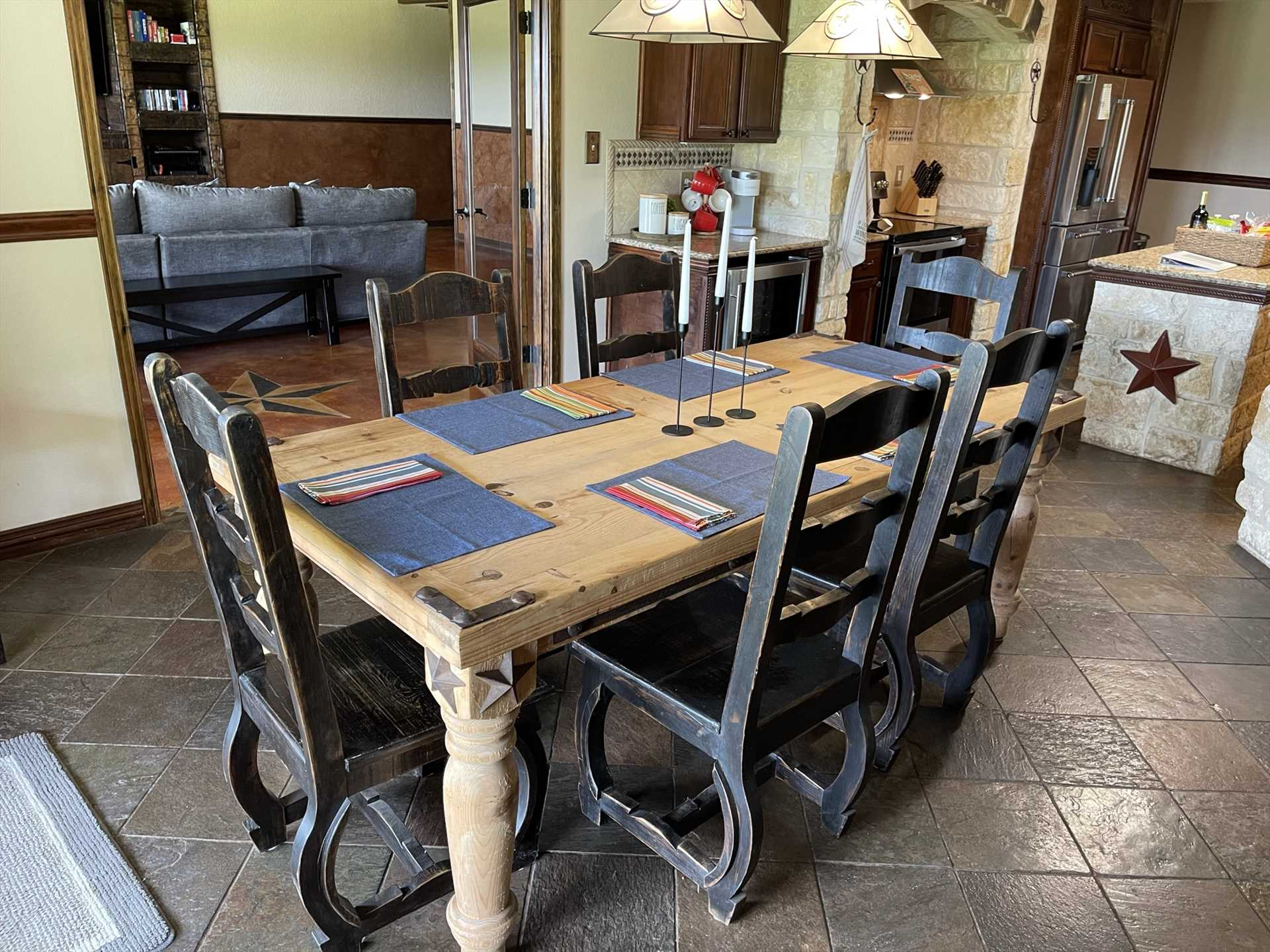 Ample seating space with tasteful country touches make the dining area a wonderful place to gather.