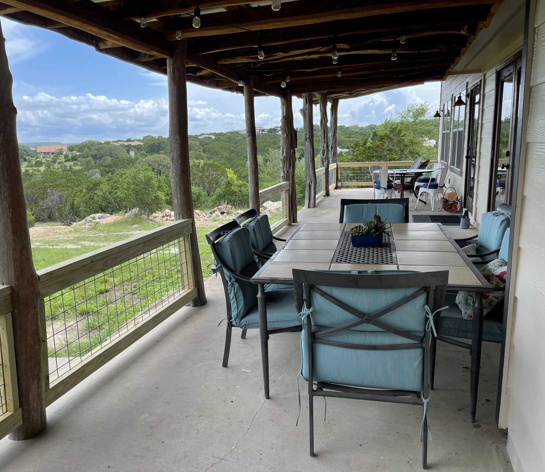 Comfortable seating on the shaded patio gives you incredible Hill Country views from your mountain perch!