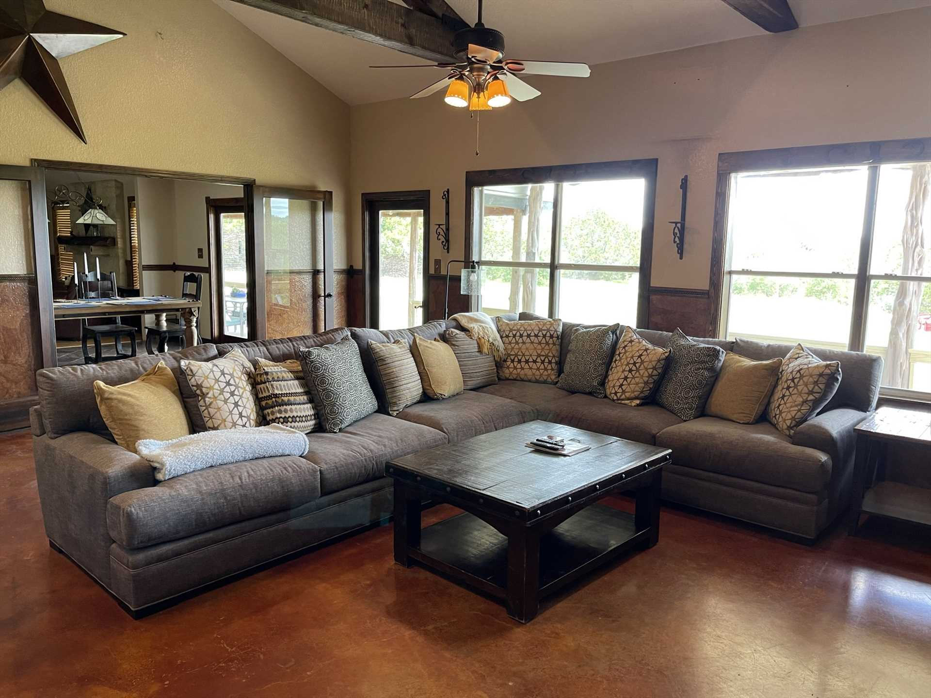 The enormous and comfortable living area sets the perfect stage for games, movie nights, and conversation!