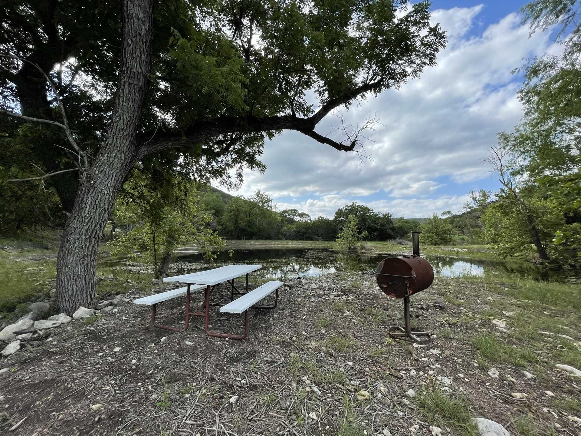 Take in a fresh-air picnic on the shore of your private pond.