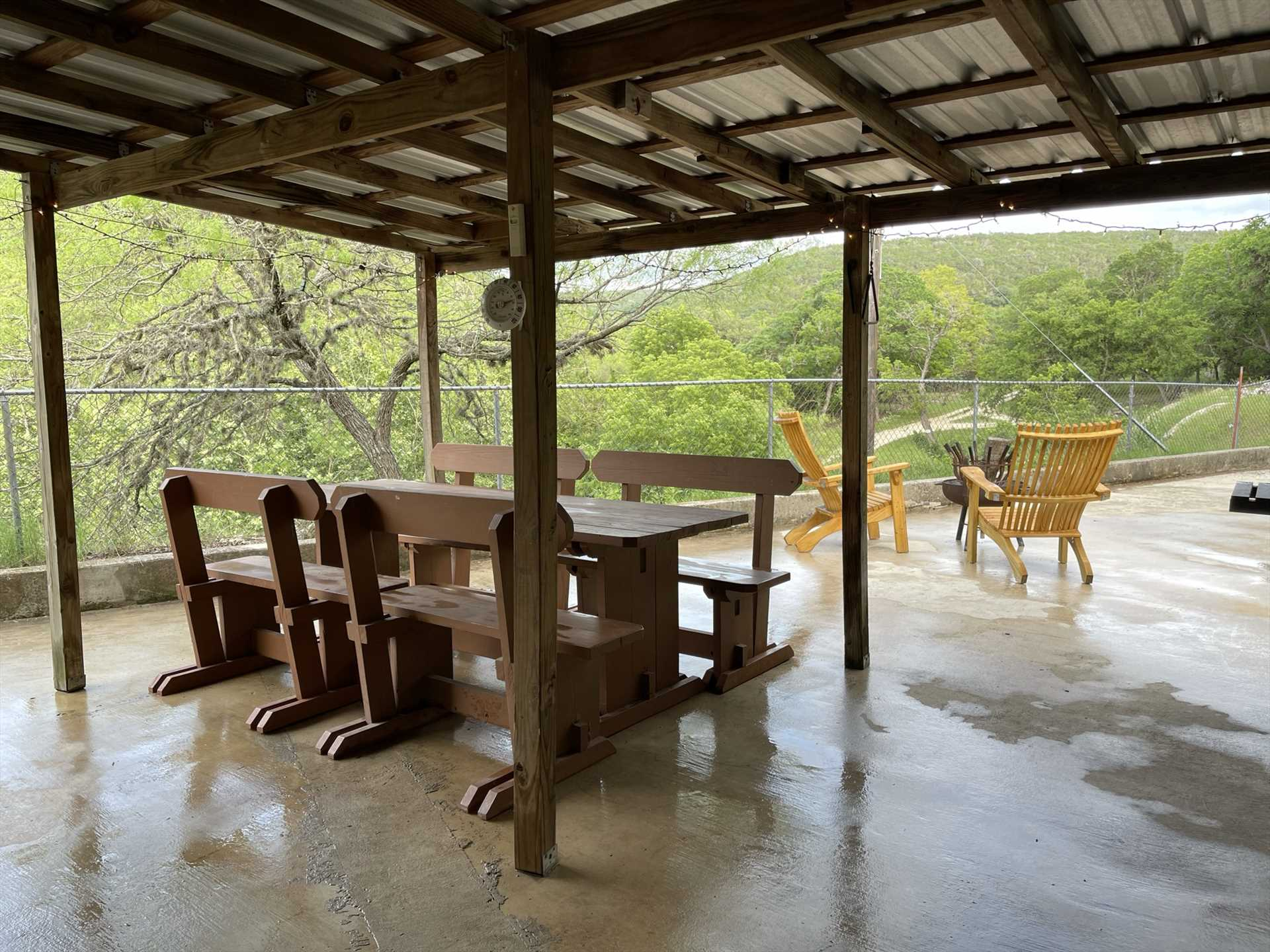 The shady outdoor patio is a wonderful place to watch wildlife and take in those amazing Hill Country views.