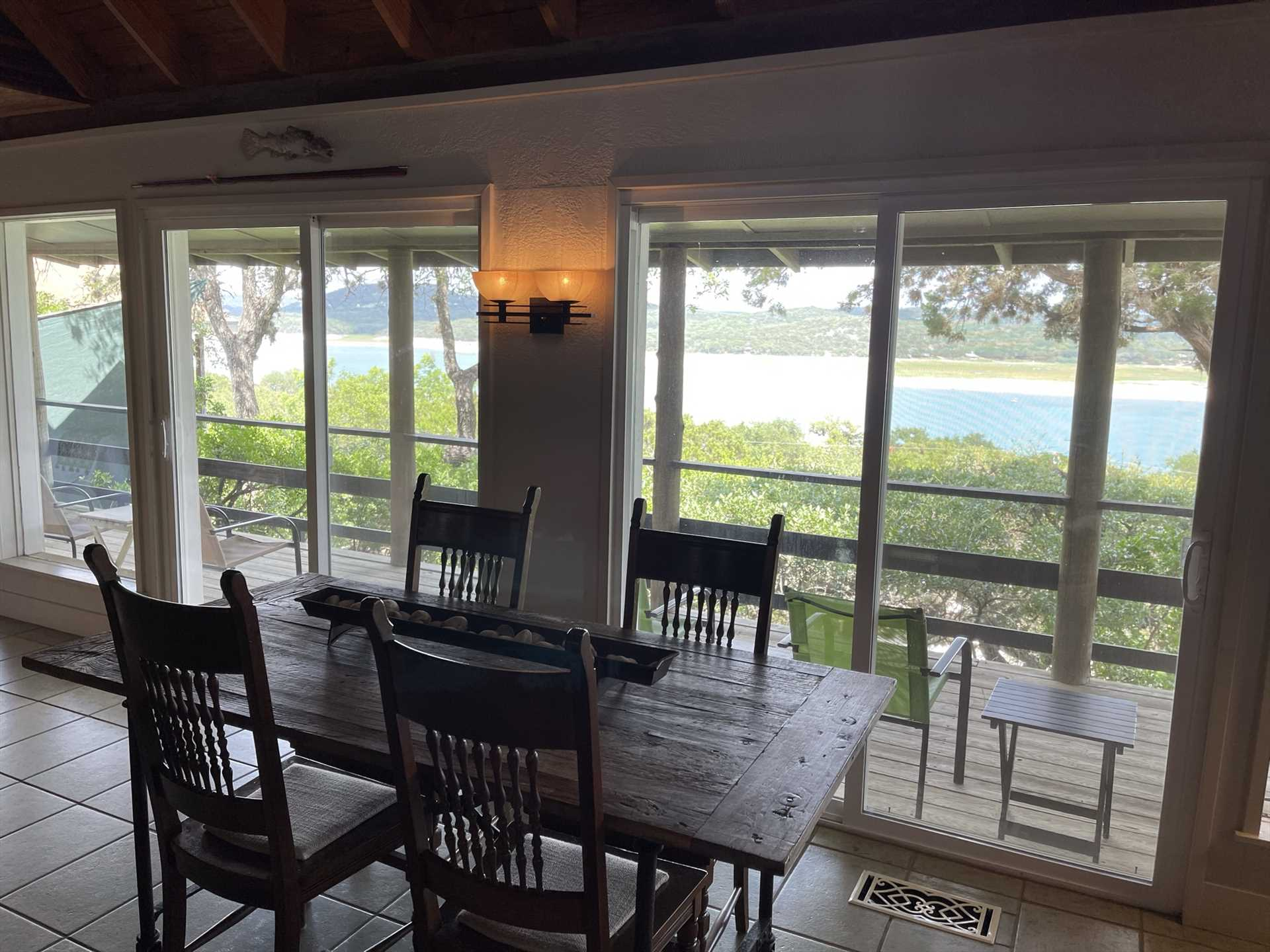 Plenty of windows facing the back deck give you access to inspiring lake views from inside, too!