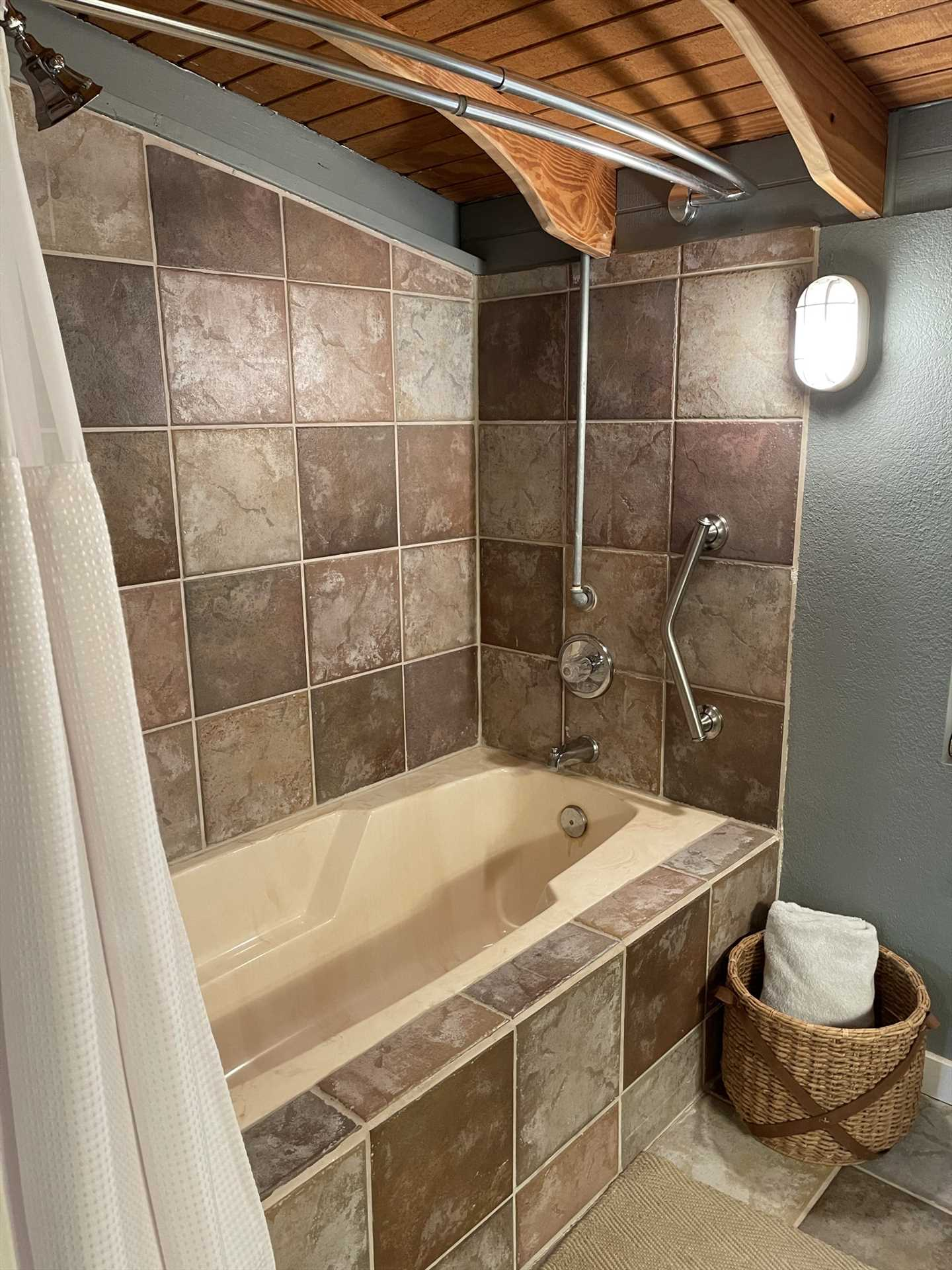 Stylish tile work and a shower/tub combo make the second bath a tidy and classy cleanup space!