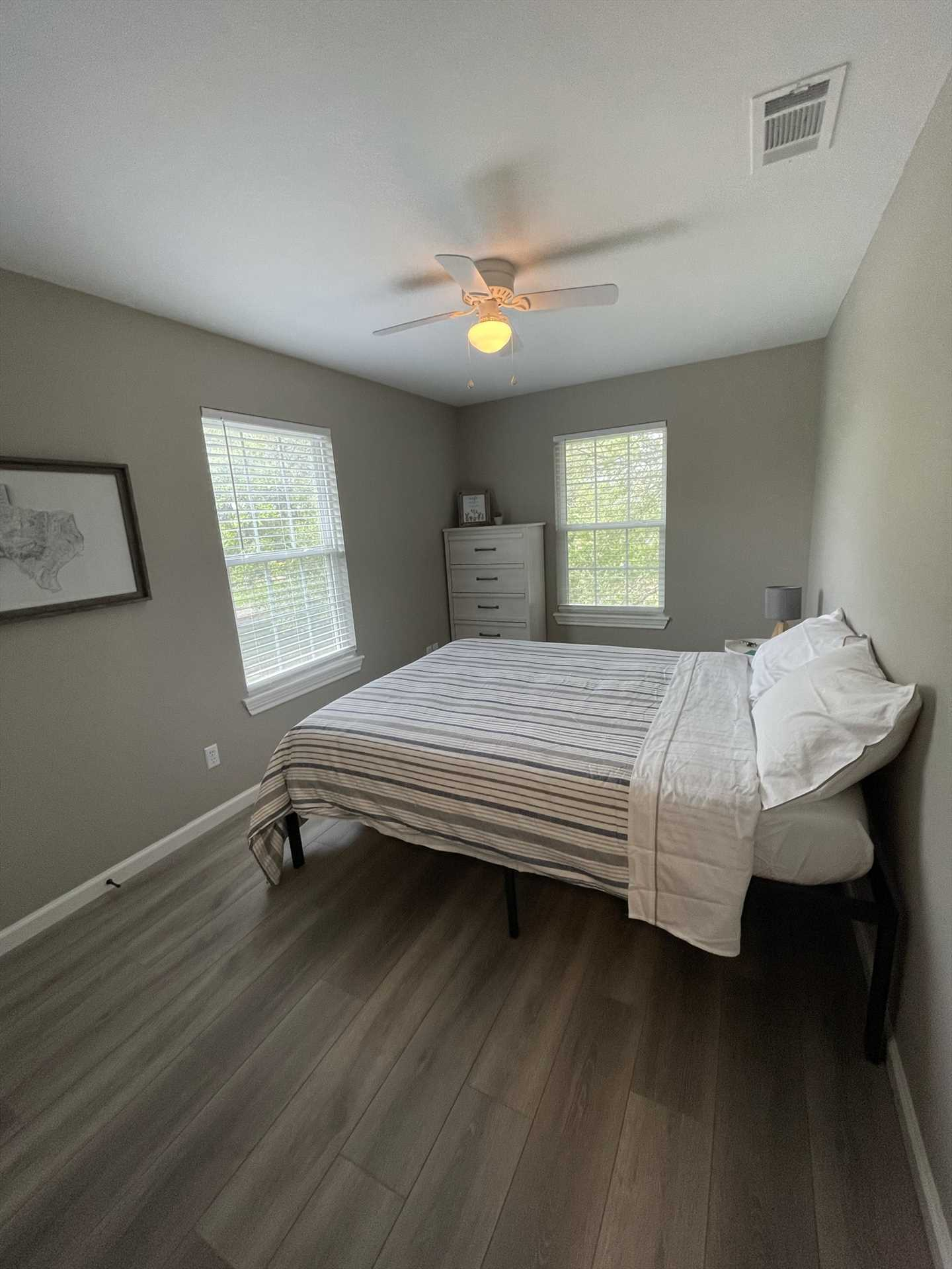 The second bedroom is tastefully appointed with a plush and comfortable queen-size bed.