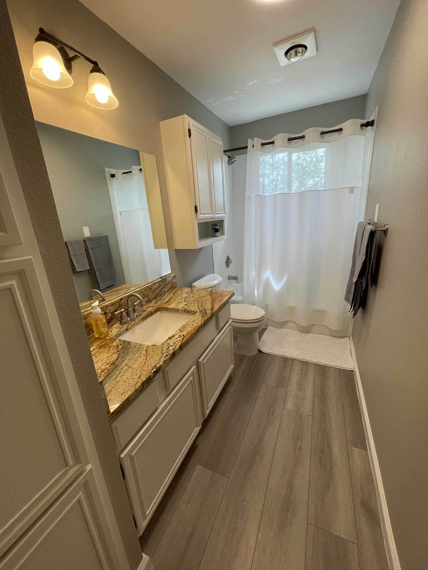 Upstairs features a full bath with a shower and tub combo. Both baths include fluffy and clean bathroom linens.