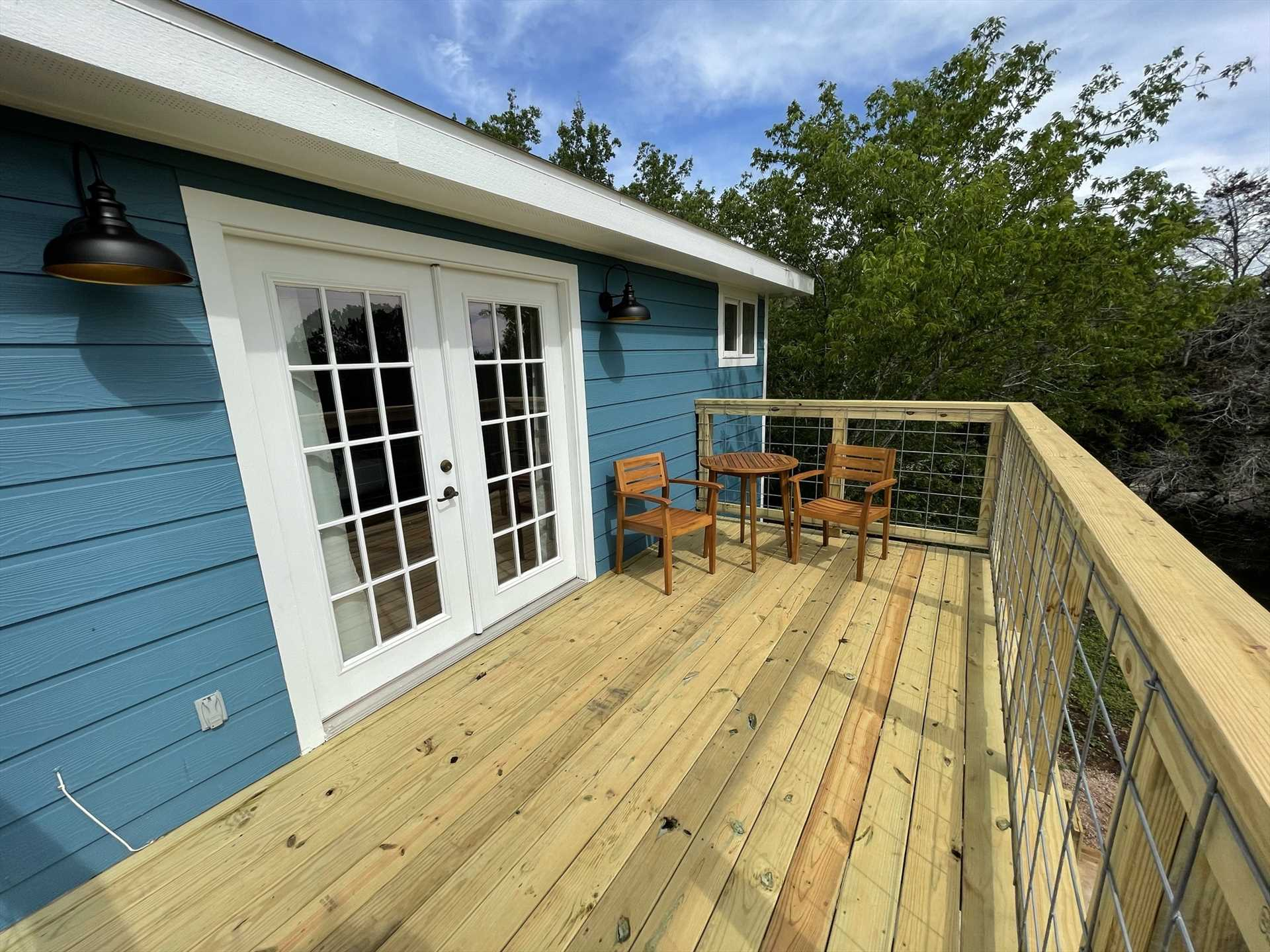 A newly-renovated deck off the master bedroom offers inspiring eagle-eye views of the surrounding Hill Country!