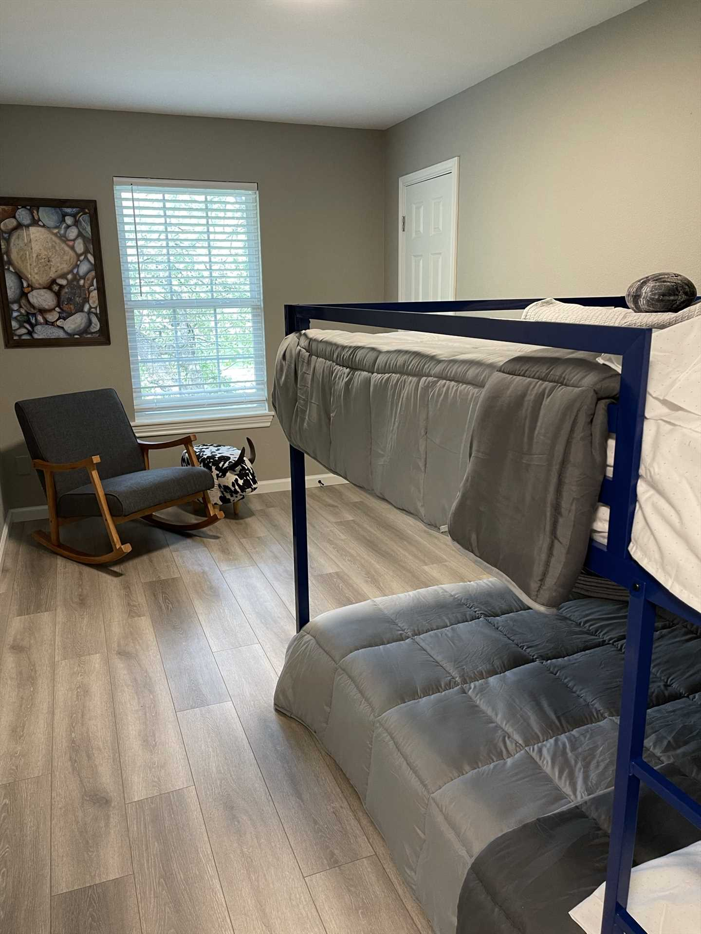 Full-sized bunk beds sleep up to four guests in the third bedroom. Save the upper bunks for the kids!