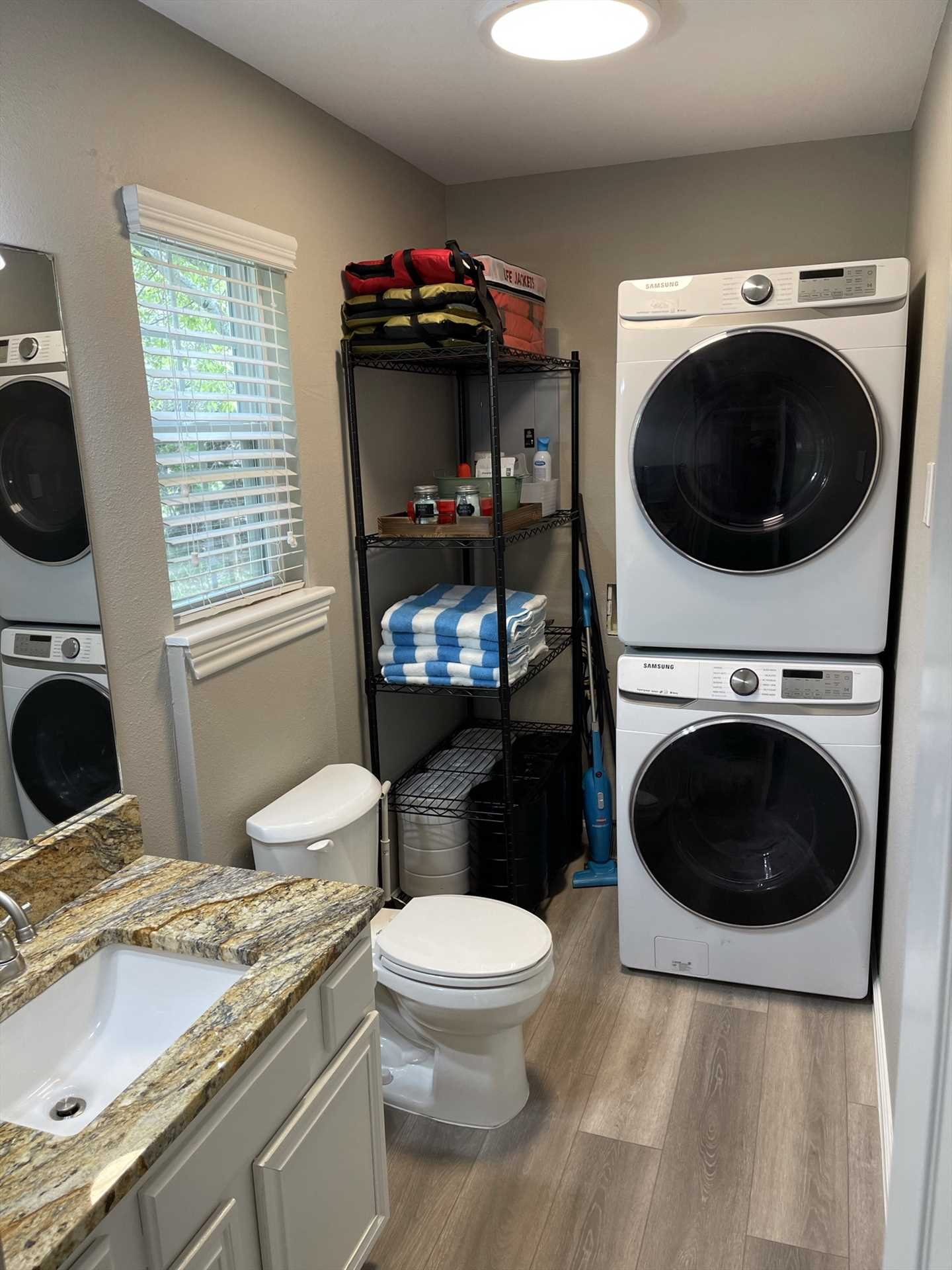 The tidy downstairs half-bath includes a washer and dryer for your convenience, too.