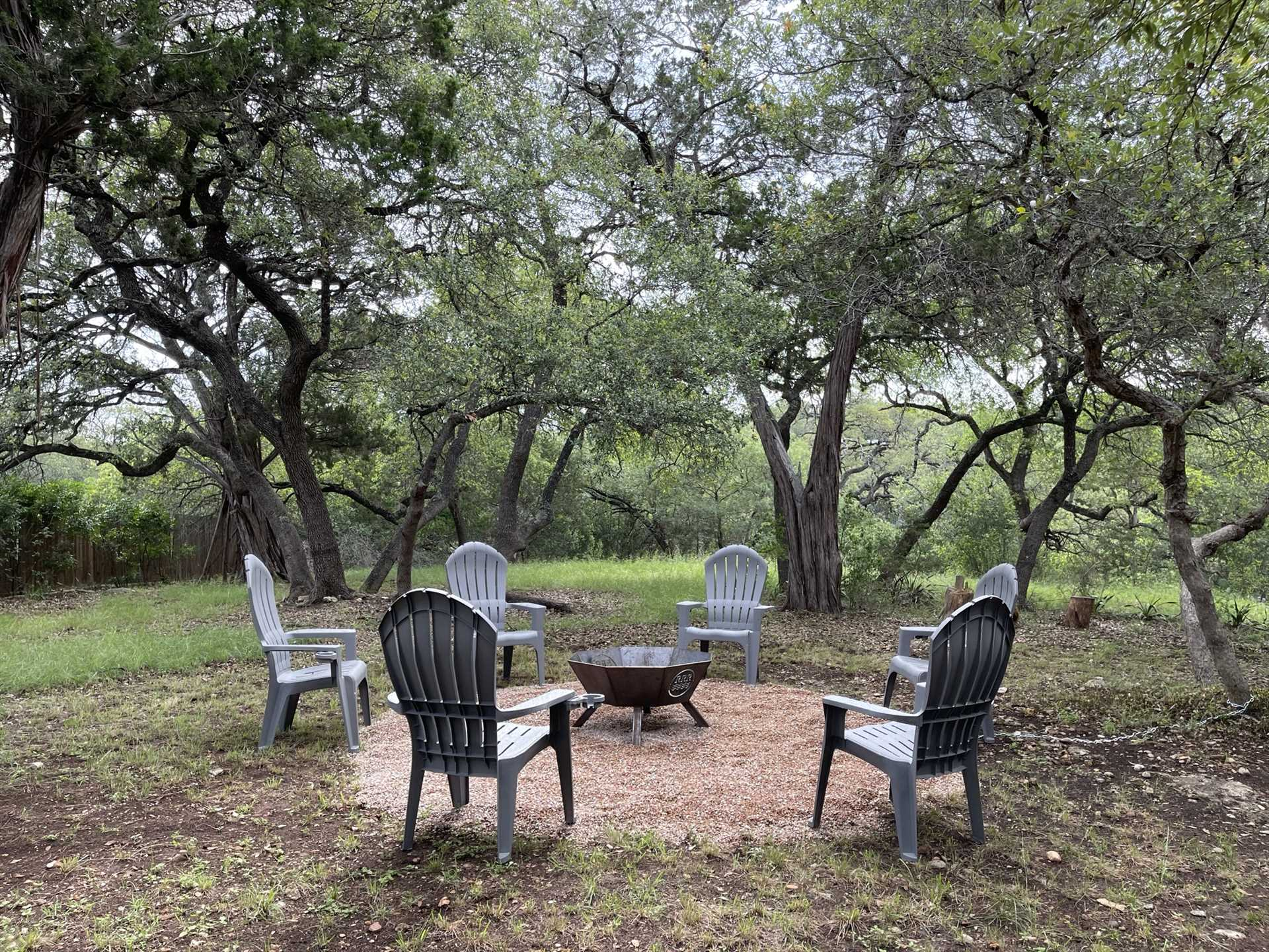 Comfortable seating encircles the fire pit, and it's the perfect stage for roasting snacks, chatting, and stargazing!