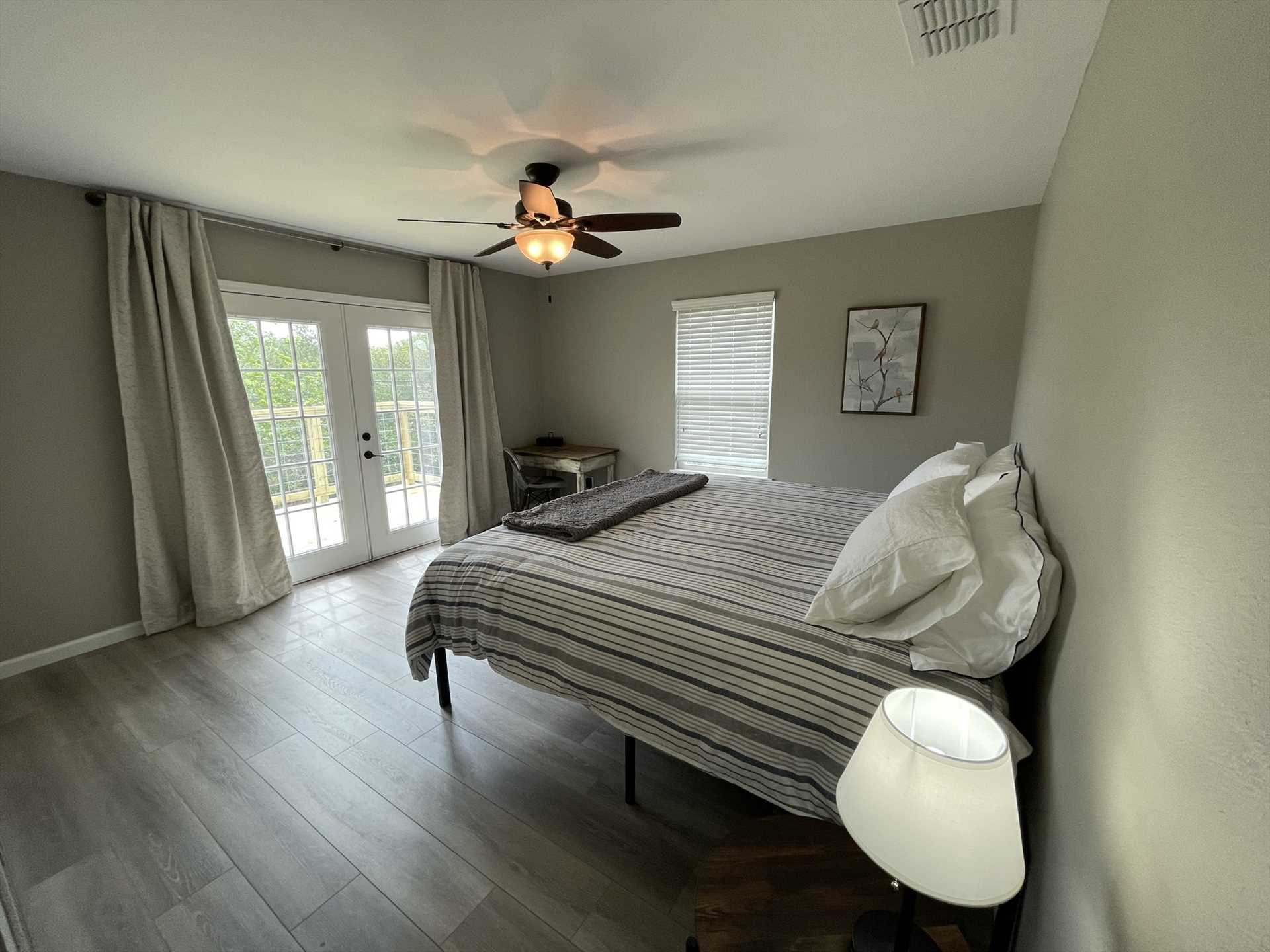 A big king-sized bed provides comfy sleep for two in the master bedroom, and French doors open out to a private deck!
