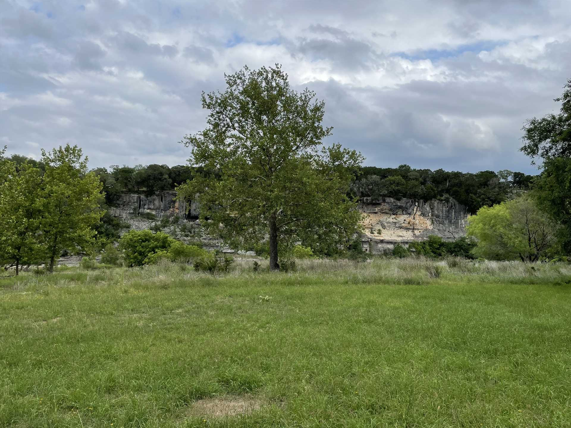Your section of the Medina is bracketed on the other side by a picturesque limestone bluff.